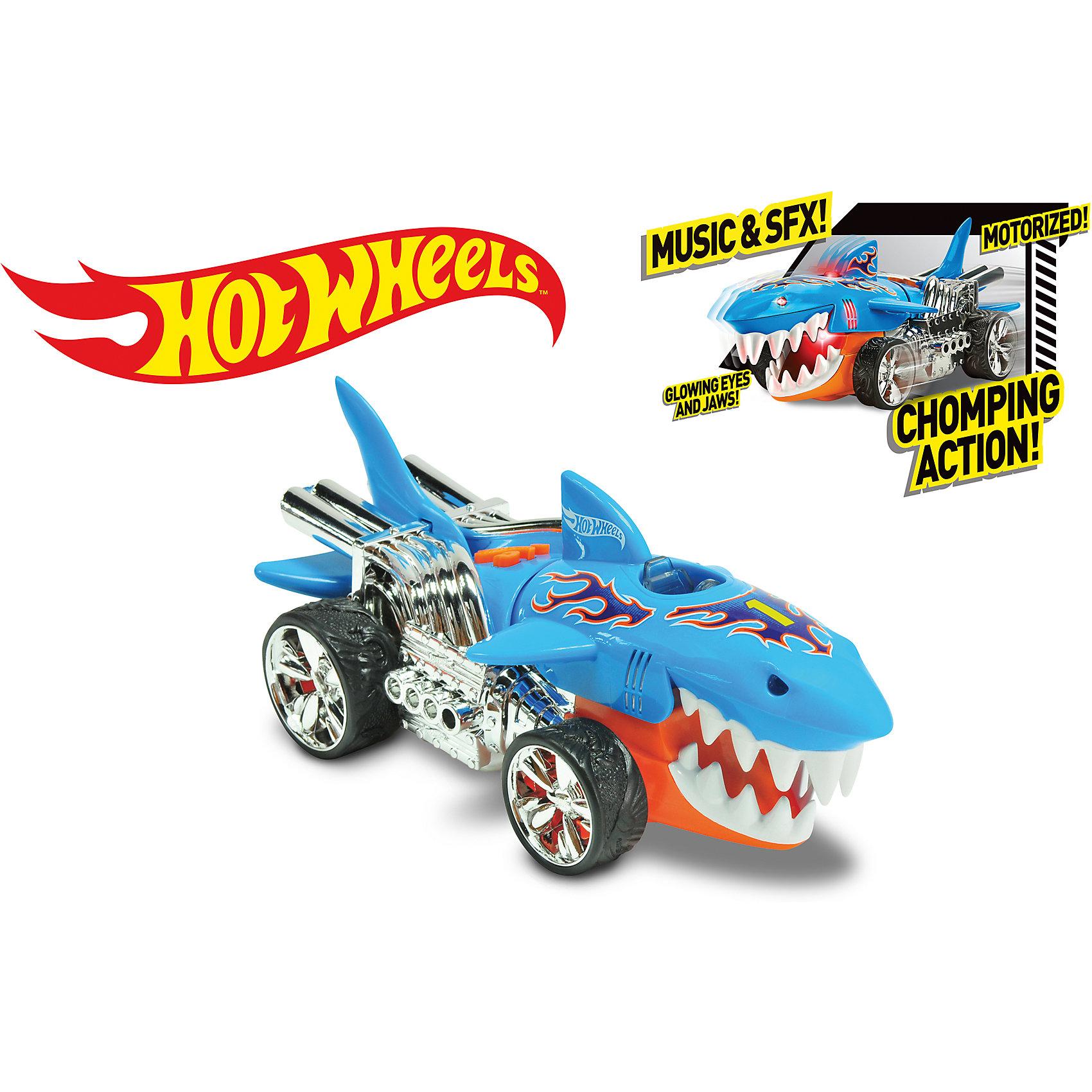 Машинка на батарейках Голубая акула, 23 см, Hot WheelsМашинка-монстр Хот Вилс электромеханическая, на батарейках, свет+звук.<br><br>Характеристики гоночной машинки в виде акулы Hot Wheels:<br><br>• световые эффекты: мигающие лампочки;<br>• звуковые эффекты: работающий мотор, лязг шин;<br>• внешний вид: огромная акула на корпусе, зубастая челюсть, хромированные диски;<br>• функциональность модели: у акулы во время движения открывается и закрывается пасть;<br>• электронная модель: работает от батареек;<br>• батарейки входят в комплект: 3 шт. типа ААА;<br>• длина машинки: 23 см;<br>• размер упаковки: 27,3х12,7х12,7 см;<br>• вес упаковки: 454 г.<br><br>Скоростные гонки, жажда скорости, молниеносный старт – гоночные машинки Hot Wheels порадуют мальчишек агрессивным видом и оформлением капота фигуркой акулы с подвижной челюстью. Машинка Hot Wheels с электромеханической подвеской и мощными выхлопными трубами. <br><br>Машинку на батарейках Голубая акула, 23 см, Hot Wheels можно купить в нашем интернет-магазине.<br><br>Ширина мм: 130<br>Глубина мм: 130<br>Высота мм: 270<br>Вес г: 513<br>Возраст от месяцев: 36<br>Возраст до месяцев: 2147483647<br>Пол: Мужской<br>Возраст: Детский<br>SKU: 5066700