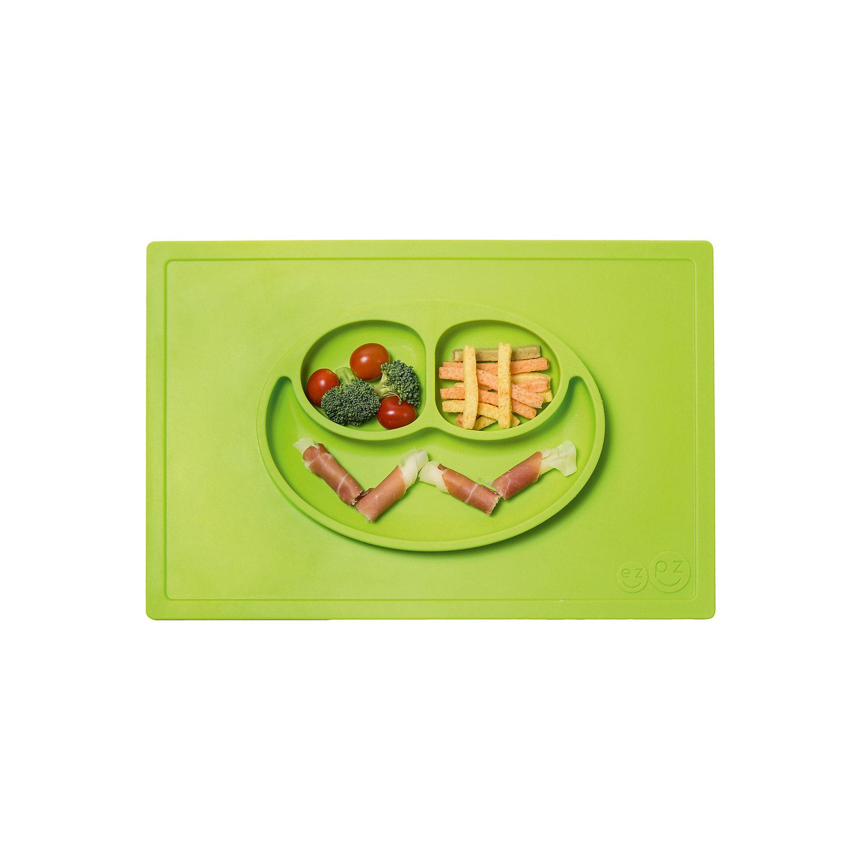 Тарелка с подставкой Happy Mat, ezpz, зеленыйТарелка с подставкой Happy Mat, ezpz, зеленый.<br><br>Характеристики:<br>• изготовлена из качественного пищевого силикона<br>• надежно крепится к столу<br>• сгибается по краям<br>• 3 отсека для еды<br>• подходит для посудомоечной машины и микроволновой печи<br>• не содержит бисфенол, свинец, фталаты, поливинилхлорид<br>• приятный дизайн<br>• состав: 100% силикон<br>• размер: 38х25,5х3 см<br>• объем: 540 мл<br>• цвет: зеленый<br><br>Тарелка с подставкой Happy Mat, ezpz пригодится, если в доме живут маленькие непоседы. Тарелка имеет 3 глубоких отсека, что позволяет подавать еду раздельно. Вы сможете одновременно подать к столу мясо, гарнир и фрукты, не пачкая лишнюю посуду. Дно тарелки надежно крепится к плоской поверхности - вы можете не переживать, что малыш опрокинет еду и обожжется. Приятный дизайн тарелки понравится ребенку, и он обязательно будет есть с аппетитом!<br><br>Тарелку с подставкой Happy Mat, ezpz, зеленый можно купить в нашем интернет-магазине.<br><br>Ширина мм: 380<br>Глубина мм: 25<br>Высота мм: 255<br>Вес г: 701<br>Возраст от месяцев: 0<br>Возраст до месяцев: 36<br>Пол: Унисекс<br>Возраст: Детский<br>SKU: 5068704