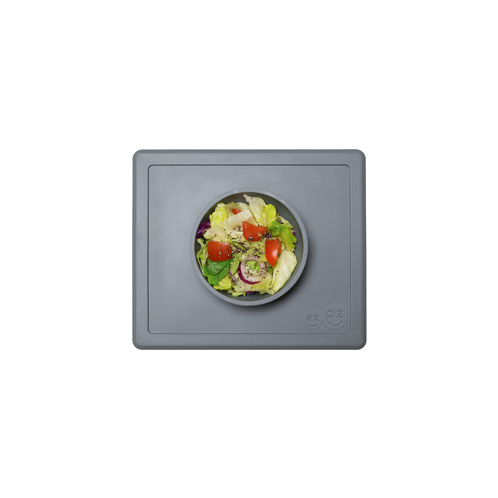 Тарелка глубокая с подставкой Happy Bowl, 240 мл., ezpz, серыйПосуда для малышей<br>Тарелка с подставкой Happy Bowl, ezpz, серый.<br><br>Характеристики:<br>• изготовлена из качественного пищевого силикона<br>• не содержит бисфенол, свинец, фталаты и ПВХ<br>• надежно прикрепляется к столу<br>• не имеет присосок<br>• сгибается по краям<br>• подходит для использования в посудомоечной машине и микроволновой печи<br>• состав: 100% силикон<br>• размер: 26,5х22,5х3,5 см<br>• объем: 240 мл<br>• цвет: серый<br><br>Тарелка с подставкой Happy Bowl, ezpz отлично подойдет для детей, которые только учатся есть аккуратно. Вы можете налить ребенку суп в чашу и не бояться, что малыш прольет его, ведь тарелка надежно крепится к столу за счет своего веса. По краям мата вы сможете положить хлеб, чашку или столовые приборы. Тарелку можно греть в микроволновой печи и мыть в посудомоечной машине, что еще больше облегчает ее использование. <br><br>Тарелку с подставкой Happy Bowl, ezpz, серый можно приобрести в нашем интернет-магазине.<br><br>Ширина мм: 260<br>Глубина мм: 35<br>Высота мм: 225<br>Вес г: 460<br>Возраст от месяцев: 0<br>Возраст до месяцев: 36<br>Пол: Унисекс<br>Возраст: Детский<br>SKU: 5068708