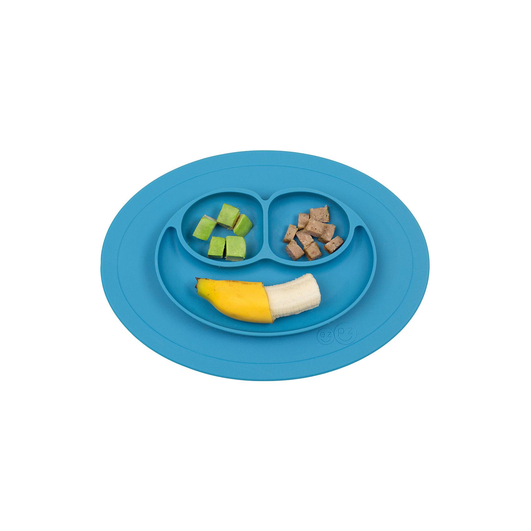 Тарелка с подставкой Mini Mat, ezpz, синийТарелка с подставкой Mini Mat, ezpz, синий.<br><br>Характеристики:<br>• изготовлена из качественного пищевого силикона<br>• надежно крепится к столу<br>• 3 отсека для еды<br>• удобно брать с собой<br>• подходит для посудомоечной машины и микроволновой печи<br>• не содержит бисфенол, свинец, фталаты, поливинилхлорид<br>• приятный дизайн<br>• состав: 100% силикон<br>• размер: 21,5х19,5х2,5 см<br>• объем: 240 мл<br>• цвет: синий<br><br>Тарелка с подставкой Mini Mat, ezpz пригодится, если в доме живут маленькие непоседы. Тарелка имеет 3 глубоких отсека, что позволяет подавать еду раздельно. Вы сможете одновременно подать к столу мясо, гарнир и фрукты, не пачкая лишнюю посуду. Дно тарелки надежно крепится к плоской поверхности - вы можете не переживать, что малыш опрокинет еду и обожжется. Небольшой размер позволит брать тарелку с собой в дорогу. Приятный дизайн тарелки понравится ребенку, и он обязательно будет есть с аппетитом!<br><br><br>Вы можете купить тарелку с подставкой Mini Mat, ezpz, синий в нашем интернет-магазине.<br><br>Ширина мм: 210<br>Глубина мм: 25<br>Высота мм: 195<br>Вес г: 323<br>Возраст от месяцев: 0<br>Возраст до месяцев: 36<br>Пол: Унисекс<br>Возраст: Детский<br>SKU: 5068712