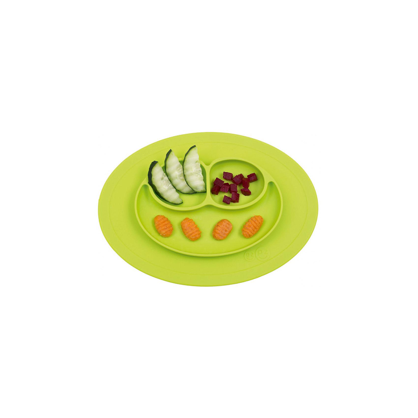 Тарелка малая с подставкой Mini Mat, 240 мл., ezpz, зеленыйПосуда для малышей<br>Тарелка с подставкой Mini Mat, ezpz, зеленый.<br><br>Характеристики:<br>• изготовлена из качественного пищевого силикона<br>• надежно крепится к столу<br>• 3 отсека для еды<br>• удобно брать с собой<br>• подходит для посудомоечной машины и микроволновой печи<br>• не содержит бисфенол, свинец, фталаты, поливинилхлорид<br>• приятный дизайн<br>• состав: 100% силикон<br>• размер: 21,5х19,5х2,5 см<br>• объем: 240 мл<br>• цвет: зеленый<br><br>Тарелка с подставкой Mini Mat, ezpz пригодится, если в доме живут маленькие непоседы. Тарелка имеет 3 глубоких отсека, что позволяет подавать еду раздельно. Вы сможете одновременно подать к столу мясо, гарнир и фрукты, не пачкая лишнюю посуду. Дно тарелки надежно крепится к плоской поверхности - вы можете не переживать, что малыш опрокинет еду и обожжется. Небольшой размер позволит брать тарелку с собой в дорогу. Приятный дизайн тарелки понравится ребенку, и он обязательно будет есть с аппетитом!<br><br><br>Вы можете купить тарелку с подставкой Mini Mat, ezpz, зеленый в нашем интернет-магазине.<br><br>Ширина мм: 210<br>Глубина мм: 25<br>Высота мм: 195<br>Вес г: 323<br>Возраст от месяцев: 0<br>Возраст до месяцев: 36<br>Пол: Унисекс<br>Возраст: Детский<br>SKU: 5068715