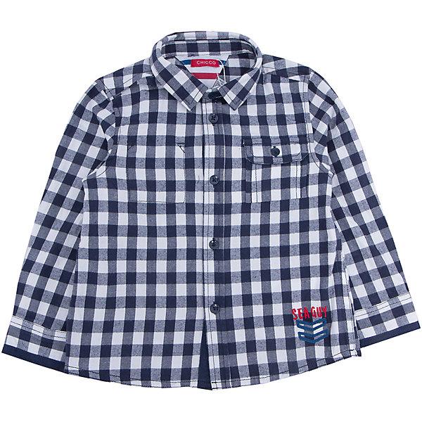 Рубашка   для мальчика CHICCOБлузки и рубашки<br>Рубашка CHICCO для мальчика<br><br>Характеристики:<br><br>Материал: хлопковая ткань<br>Силуэт: свободный<br>Тип застежки: пуговицы<br>Длина рукава: длинные<br>Тип карманов: один боковой, застегивается на пуговицу<br>Принт: клетка<br><br>Состав: 100% хлопок<br><br>Рубашку CHICCO для мальчика можно купить в нашем интернет-магазине.<br><br>Ширина мм: 190<br>Глубина мм: 74<br>Высота мм: 229<br>Вес г: 236<br>Цвет: синий<br>Возраст от месяцев: 48<br>Возраст до месяцев: 60<br>Пол: Мужской<br>Возраст: Детский<br>Размер: 110,116,104,98,92,128,122<br>SKU: 5082508