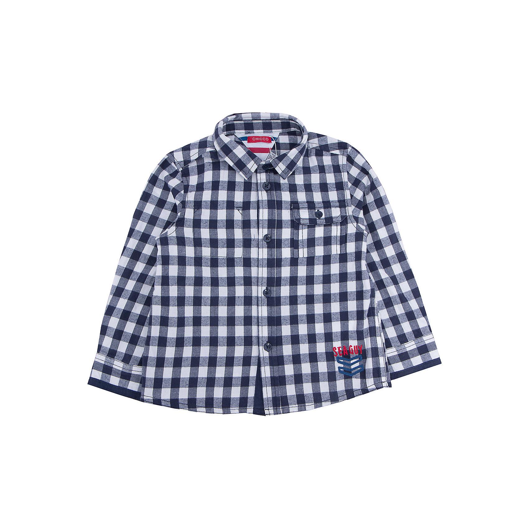 Рубашка   для мальчика CHICCOБлузки и рубашки<br>Рубашка CHICCO для мальчика<br><br>Характеристики:<br><br>Материал: хлопковая ткань<br>Силуэт: свободный<br>Тип застежки: пуговицы<br>Длина рукава: длинные<br>Тип карманов: один боковой, застегивается на пуговицу<br>Принт: клетка<br><br>Состав: 100% хлопок<br><br>Рубашку CHICCO для мальчика можно купить в нашем интернет-магазине.<br><br>Ширина мм: 190<br>Глубина мм: 74<br>Высота мм: 229<br>Вес г: 236<br>Цвет: синий<br>Возраст от месяцев: 84<br>Возраст до месяцев: 96<br>Пол: Мужской<br>Возраст: Детский<br>Размер: 128,92,98,104,110,116,122<br>SKU: 5082508