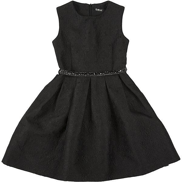 Нарядное платье для девочки GulliverОдежда<br>Платье для девочки от известного бренда Gulliver.<br>Какими должны быть нарядные платья 2016/2017? Разными! Кто-то предпочитает купить платье  - пышную модель как у настоящей принцессы, но кто-то выбирает стильные лаконичные решения с изюминкой и загадкой. Черное платье из благородного жаккардового полотна - идеальный вариант для тех, кто ценит изящество и элегантность. Пояс, расшитый стразами подчеркнет торжественность момента.<br>Состав:<br>верх: 100% полиэстер; подкладка: 100% хлопок<br>Ширина мм: 236; Глубина мм: 16; Высота мм: 184; Вес г: 177; Цвет: черный; Возраст от месяцев: 72; Возраст до месяцев: 84; Пол: Женский; Возраст: Детский; Размер: 134,128,122,140; SKU: 5103489;