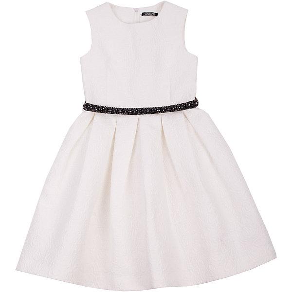 Нарядное платье для девочки GulliverОдежда<br>Платье для девочки от известного бренда Gulliver.<br>Какими должны быть нарядные платья 2016/2017? Разными! Кто-то предпочитает купить платье  - пышную модель как у настоящей принцессы, но кто-то выбирает стильные лаконичные решения с изюминкой и загадкой. Нежное молочное платье из благородного жаккардового полотна - идеальный вариант для тех, кто ценит изящество и элегантность. Черный пояс, расшитый стразами подчеркнет торжественность момента.<br>Состав:<br>верх: 100% полиэстер; подкладка: 100% хлопок<br><br>Ширина мм: 236<br>Глубина мм: 16<br>Высота мм: 184<br>Вес г: 177<br>Цвет: белый<br>Возраст от месяцев: 108<br>Возраст до месяцев: 120<br>Пол: Женский<br>Возраст: Детский<br>Размер: 140,134,128,122<br>SKU: 5103494