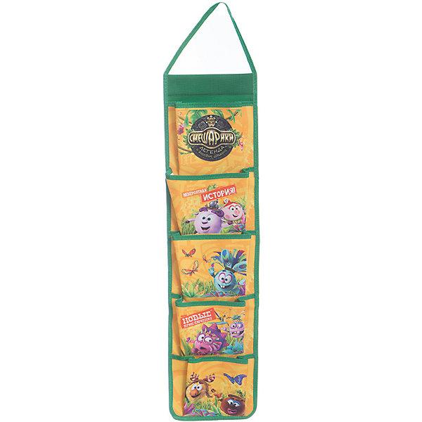 Органайзер подвесной Смешарики, высота 65 смЯщики для игрушек<br>Органайзер подвесной Смешарики, высота 65 см, Centrum (Центрум)<br><br>Характеристики:<br><br>• 5 вместительных карманов<br>• яркий дизайн с героями мультфильма<br>• высота: 65 см<br>• материал: полиэстер 600 ден<br>• размер кармана: 15х13 см<br>• размер упаковки: 21х30х5 см<br><br>Органайзер - необходимая вещь для каждого ребенка, любящего порядок. Органайзер Смешарики содержит 5 вместительных карманов размеров 15х13 см. Сверху есть специальная ручка, с помощью которой вы сможете повесить органайзер. А изображение любимых Смешариков всегда будет радовать ребенка!<br><br>Органайзер подвесной Смешарики, высота 65 см, Centrum (Центрум) вы можете купить в нашем интернет-магазине.<br>Ширина мм: 50; Глубина мм: 210; Высота мм: 300; Вес г: 150; Возраст от месяцев: 36; Возраст до месяцев: 120; Пол: Унисекс; Возраст: Детский; SKU: 5175356;