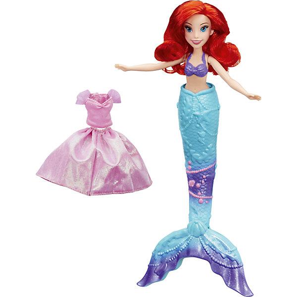 Кукла Принцесса Ариель, превращающаяся  из Русалки в девушку, Принцессы ДиснейИгрушки<br>Кукла Принцесса Ариель, превращающаяся  из Русалки в девушку, Принцессы Дисней<br><br>Характеристики:<br><br>- в набор входит: кукла, платье, хвост русалки <br>- состав: пластик, текстиль<br>- для детей в возрасте: от 3 до 10 лет<br>- Страна производитель: Китай<br><br>Прекрасная принцесса подводного царства Ариэль известна по мультфильмам компании Дисней. Эта кукла изготовлена по лицензии правообладателя известным американским производителем товаров для детей Hasbro (Хасбро). Кукла с большими и выразительными глазами выглядит просто великолепно. Ее пышные рыжие волосы прошиты по всей голове, фиолетовый топик нарисован и детализирован рельефными аксессуарами, его нельзя снимать. <br><br>Хвост русалки отдекорирован под стиль ее топику. Если налить воды в хвост русалки, то он откроется и превратиться в изящные ножки. Принцесса наденет красивое розовое платье и сможет танцевать с принцем! Платье переливается и состоит из двух частей, верхнего топа и юбочки, его части можно комбинировать и с хвостом.<br><br>Кукла может поворачивать голову, расставлять в разные стороны руки и поворачивать их в плечах, также может поворачивать ногами в бедрах. Отправьтесь на встречу приключениям вместе с принцессой Ариэль. Игры с куклами развивают социальные навыки, развивают воображение и творческие способности. <br><br>Куклу Принцесса Ариель, превращающаяся  из Русалки в девушку, Принцессы Дисней можно купить в нашем интернет-магазине.<br><br>Ширина мм: 324<br>Глубина мм: 203<br>Высота мм: 66<br>Вес г: 305<br>Возраст от месяцев: 36<br>Возраст до месяцев: 84<br>Пол: Женский<br>Возраст: Детский<br>SKU: 5225701