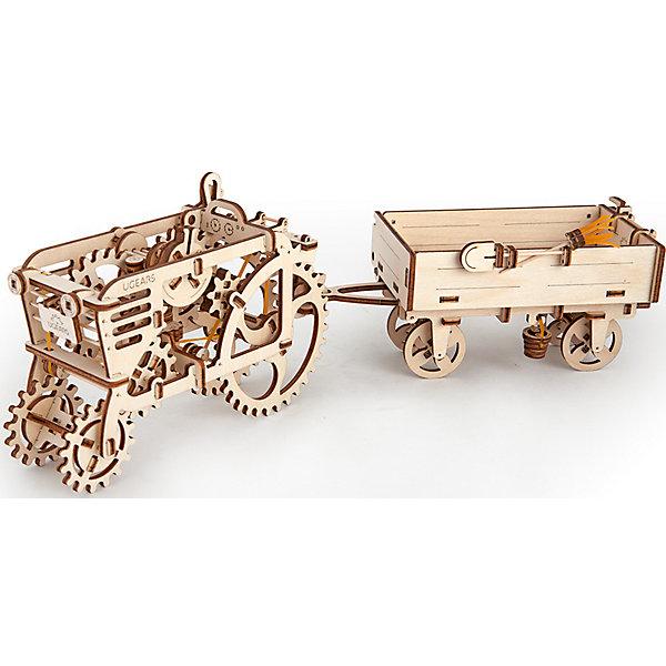 Прицеп к трактору, UGEARSДеревянные конструкторы<br>Трактору полагается правильный фермерский прицеп. Специальным рычагом можно опрокинуть борт прицепа. На нем есть все необходимое в работе, вилы, лопата, На крюке снизу болтается ведро «с болтами», а под днищем есть место, где хранится настоящая метла. В комплекте с прицепом прилагается блок с крюком,  который устанавливается на трактор и позволяет присоединять прицеп. <br>Модель для самостоятельной сборки без клея.<br><br>Размер модели: 209*101*96мм<br>Размер упаковки: 37*14*3см<br>Количество деталей: 68<br>Расчетное время сборки: 1-2 часа<br>Ширина мм: 375; Глубина мм: 140; Высота мм: 30; Вес г: 362; Возраст от месяцев: 168; Возраст до месяцев: 192; Пол: Унисекс; Возраст: Детский; SKU: 5226401;