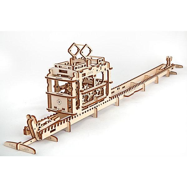 Трамвай с рельсами, UGEARSДеревянные конструкторы<br>Трамвайчик UGEARS самая романтичная модель коллекции. Он может перевезти послание на другой край стола. <br>Заводится специальным колесиком на крыше. Имеет встроенную коробочку для записок.  Эта модель может работать не только на резиномоторе но и как фуникулер. На обеих концах пути, есть специальные рычаги, которыми можно поднимать дорогу и спускать по ней вагончик друг другу. <br>Если рычаги поднять и зафиксировать дорога превратится в мост.<br>«Токоприемник» трамвая служит рычагом, который выдвигает наверх колесо завода.  На крыше также расположен рычаг переключения направления завода, рычаг запуска трамвая и фиксатор положения «токоприемника» и крышки коробочки. Внизу, с обеих сторон трамвая выдвижные крючки-сцепки.  В нем также есть открывающийся запасной выход на крышу.<br>Модель для самостоятельной сборки без клея.<br><br>Размер модели с рельсами: 767*73*160мм<br>Размер упаковки: 37*17*3см<br>Количество деталей: 154<br>Расчетное время сборки: 3-4 часа<br><br>Ширина мм: 375<br>Глубина мм: 170<br>Высота мм: 30<br>Вес г: 715<br>Возраст от месяцев: 168<br>Возраст до месяцев: 192<br>Пол: Унисекс<br>Возраст: Детский<br>SKU: 5226402