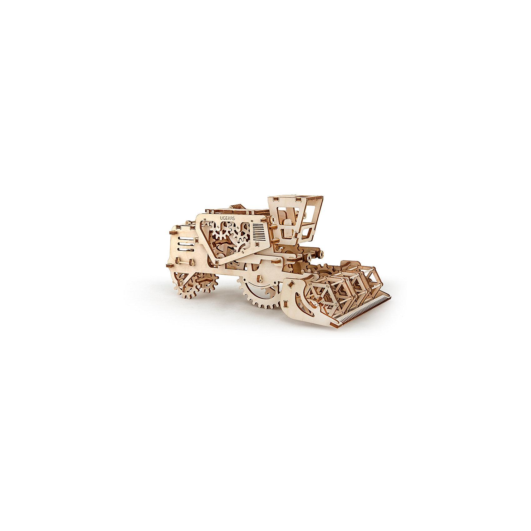 Комбайн, UGEARSДеревянные конструкторы<br>Зерноуборочный комбайн UGEARS это модель, которая порадует разнообразной механикой. При движении комбайна, спереди, как и в реальном прототипе вращается мотовило. Модель имеет встроенную секретную  коробочку. Она открывается рычагом, который находится слева от кабины. Комбайн заводится простым движением назад или вращением большого колеса.  С другой стороны от кабины есть рычаг, которым можно застопорить или запустить комбайн. Работает комбайн на резиномоторе.<br>Модель для самостоятельной сборки без клея.<br><br>Размер модели: 274*165*133мм<br>Размер упаковки: 37*17*3см<br>Количество деталей: 154<br>Расчетное время сборки: 2-3 часа<br><br>Ширина мм: 375<br>Глубина мм: 170<br>Высота мм: 30<br>Вес г: 681<br>Возраст от месяцев: 168<br>Возраст до месяцев: 192<br>Пол: Унисекс<br>Возраст: Детский<br>SKU: 5226404