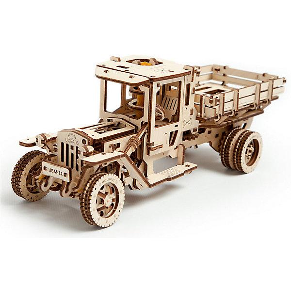 Грузовик UGM-11, UGEARSДеревянные конструкторы<br>Топовая модель - Грузовик UGM-11 - это уменьшенная копия настоящего автомобиля!<br><br>Данная модель состоит из двигателя, трансмиссии и коробки передач. Модель может двигаться как вперед, так и назад. <br>Длина автомобиля: 34 см<br>Ширина автомобиля: 14 см<br>Высота автомобиля: 13 см<br>Максимальное время снаряженная масса: 1267 г<br>Максимальная скорость: 1.8 км/ч<br><br>Дополнительная информация:<br><br>Размер грузовика: 340*140*130 мм<br>Размер упаковки: 37*17*4см<br>Количество деталей: 420<br>Расчетное время сборки: 10-12 часов<br>Ширина мм: 383; Глубина мм: 172; Высота мм: 40; Вес г: 1308; Возраст от месяцев: 168; Возраст до месяцев: 2147483647; Пол: Мужской; Возраст: Детский; SKU: 5226412;