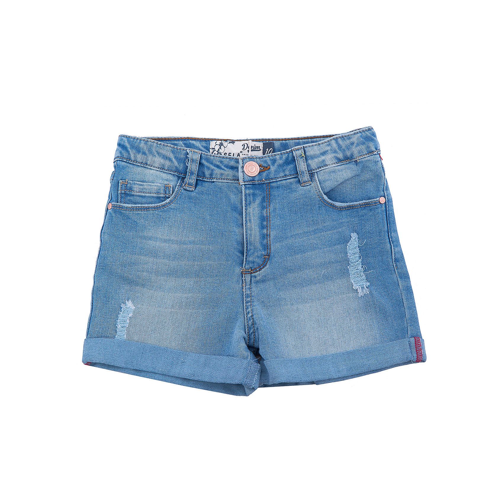 Шорты джинсовые для девочки SELAШорты, бриджи, капри<br>Характеристики товара:<br><br>• цвет: синий<br>• сезон: лето<br>• состав: 100% хлопок<br>• эффект потертостей<br>• застежка - пуговица<br>• карманы<br>• шлевки<br>• страна бренда: Россия<br><br>Вещи из новой коллекции SELA продолжают радовать удобством! Легкие джэинсовые шорты для девочки помогут разнообразить гардероб ребенка. Они отлично сочетаются с майками или футболками. <br> <br>Одежда, обувь и аксессуары от российского бренда SELA не зря пользуются большой популярностью у детей и взрослых! Модели этой марки - стильные и удобные, цена при этом неизменно остается доступной. Для их производства используются только безопасные, качественные материалы и фурнитура. Новая коллекция поддерживает хорошие традиции бренда! <br><br>Шорты для девочки от популярного бренда SELA (СЕЛА) можно купить в нашем интернет-магазине.<br><br>Ширина мм: 191<br>Глубина мм: 10<br>Высота мм: 175<br>Вес г: 273<br>Цвет: голубой<br>Возраст от месяцев: 96<br>Возраст до месяцев: 108<br>Пол: Женский<br>Возраст: Детский<br>Размер: 134,140,146,152,122,128<br>SKU: 5303048