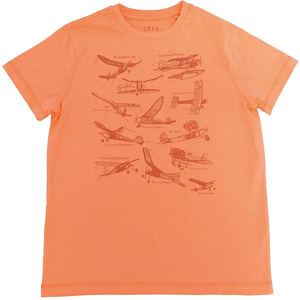 Футболка  для мальчика SELAФутболки, поло и топы<br>Характеристики товара:<br><br>• цвет: оранжевый<br>• состав: 100% хлопок<br>• принт<br>• короткие рукава<br>• округлый горловой вырез<br>• коллекция весна-лето 2017<br>• страна бренда: Российская Федерация<br><br>В новой коллекции SELA отличные модели одежды! Эта футболка для мальчика поможет разнообразить гардероб ребенка и обеспечить комфорт. Она отлично сочетается с джинсами и брюками. В составе ткани -только дышащий гипоаллергенный хлопок!<br><br>Одежда, обувь и аксессуары от российского бренда SELA не зря пользуются большой популярностью у детей и взрослых! Модели этой марки - стильные и удобные, цена при этом неизменно остается доступной. Для их производства используются только безопасные, качественные материалы и фурнитура. Новая коллекция поддерживает хорошие традиции бренда! <br><br>Футболку для мальчика от популярного бренда SELA (СЕЛА) можно купить в нашем интернет-магазине.<br><br>Ширина мм: 230<br>Глубина мм: 40<br>Высота мм: 220<br>Вес г: 250<br>Цвет: оранжевый<br>Возраст от месяцев: 84<br>Возраст до месяцев: 96<br>Пол: Мужской<br>Возраст: Детский<br>Размер: 128,122,116,152,146,140,134<br>SKU: 5304033