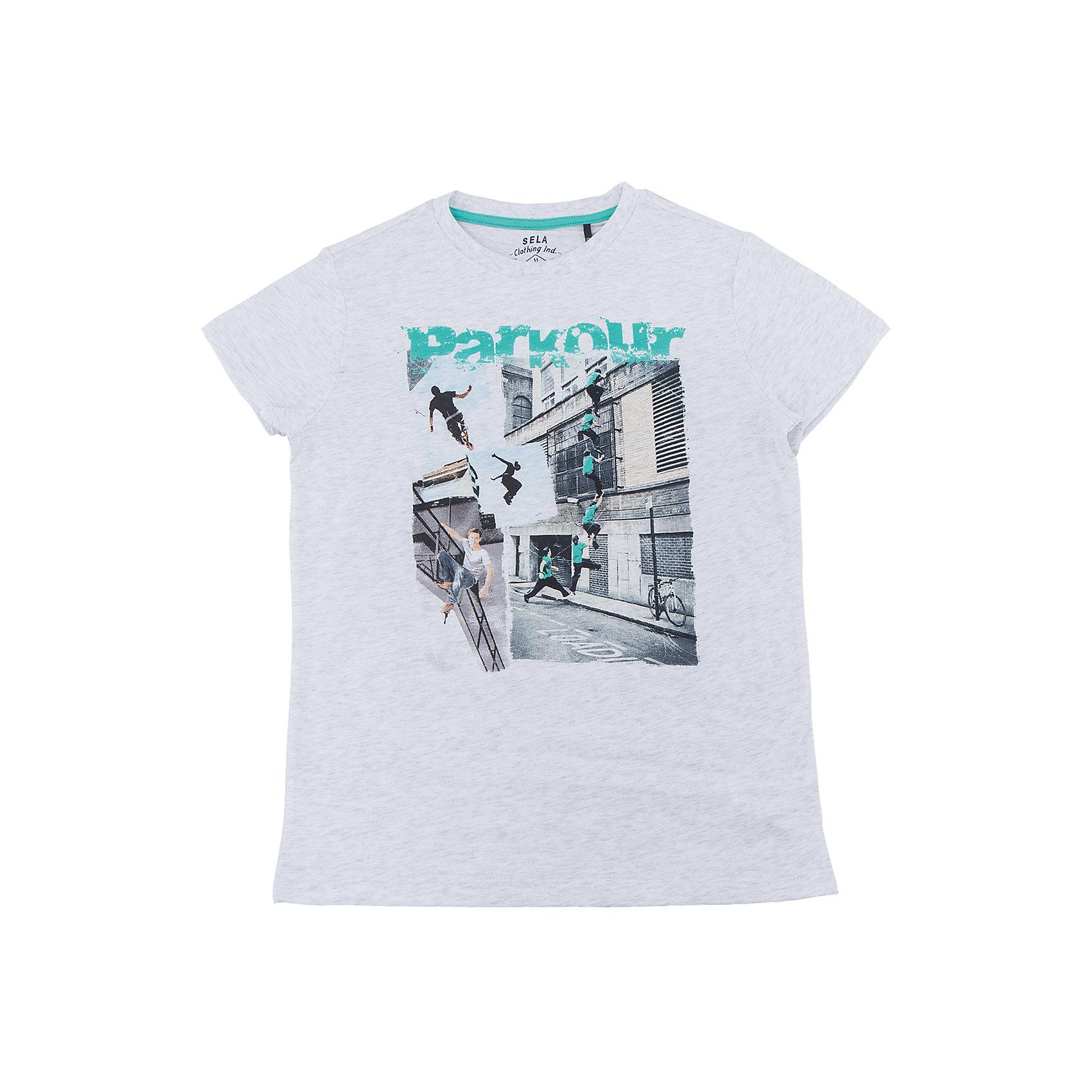 Футболка для мальчика SELAФутболки, поло и топы<br>Характеристики товара:<br><br>• цвет: белый<br>• состав: 100% хлопок<br>• принт<br>• короткие рукава<br>• округлый горловой вырез<br>• коллекция весна-лето 2017<br>• страна бренда: Российская Федерация<br><br>В новой коллекции SELA отличные модели одежды! Эта футболка для мальчика поможет разнообразить гардероб ребенка и обеспечить комфорт. Она отлично сочетается с джинсами и брюками. В составе ткани -только дышащий гипоаллергенный хлопок!<br><br>Одежда, обувь и аксессуары от российского бренда SELA не зря пользуются большой популярностью у детей и взрослых! Модели этой марки - стильные и удобные, цена при этом неизменно остается доступной. Для их производства используются только безопасные, качественные материалы и фурнитура. Новая коллекция поддерживает хорошие традиции бренда! <br><br>Футболку для мальчика от популярного бренда SELA (СЕЛА) можно купить в нашем интернет-магазине.<br><br>Ширина мм: 230<br>Глубина мм: 40<br>Высота мм: 220<br>Вес г: 250<br>Цвет: белый<br>Возраст от месяцев: 120<br>Возраст до месяцев: 132<br>Пол: Мужской<br>Возраст: Детский<br>Размер: 146,134,140,152,116,122,128<br>SKU: 5304144