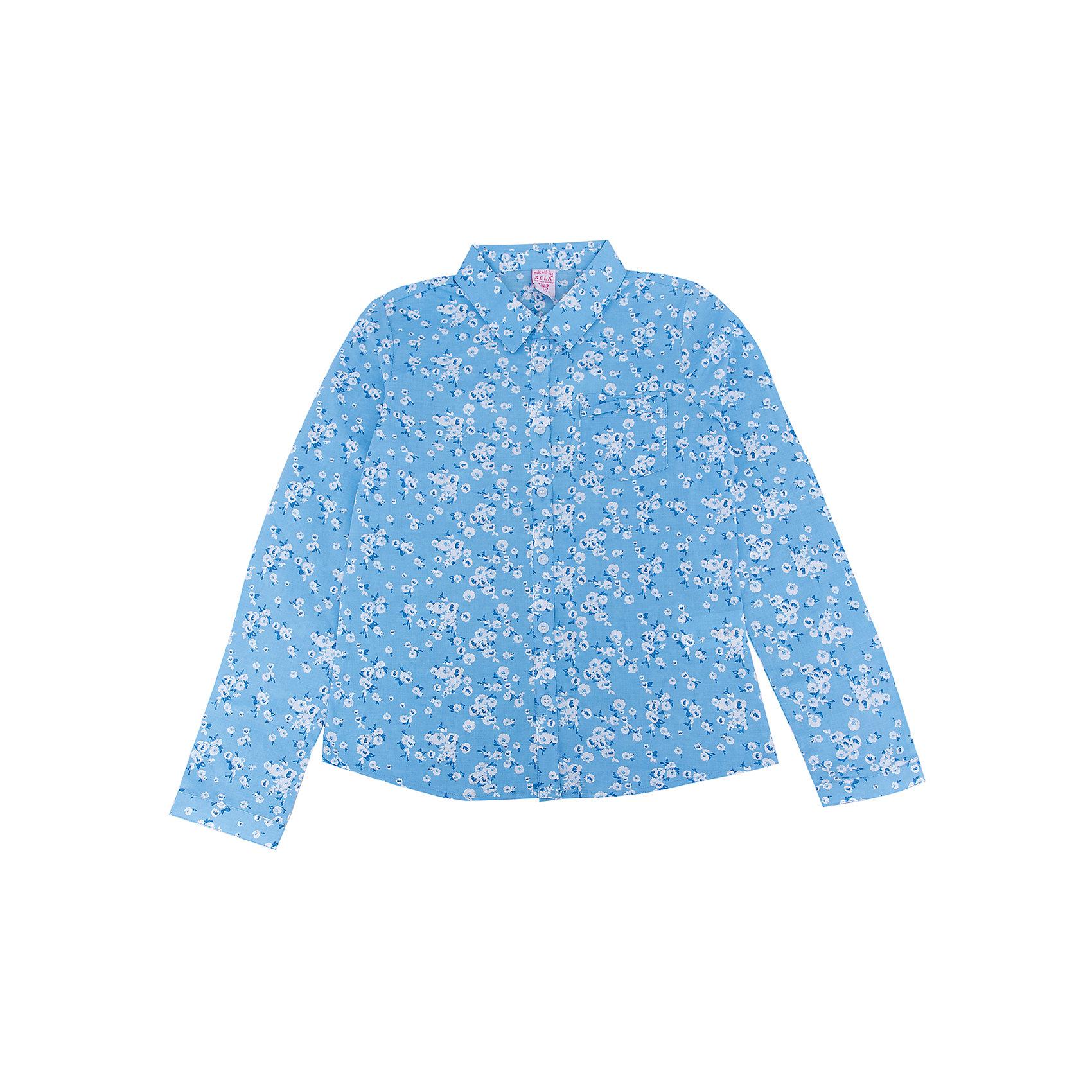 Блуза для девочки SELAБлузки и рубашки<br>Характеристики:<br><br>• Вид детской и подростковой одежды: блузка<br>• Предназначение: повседневная (для школы), праздничная<br>• Сезон: весна-лето<br>• Стиль: романтичный<br>• Тематика рисунка: цветочный<br>• Цвет: голубой принт<br>• Материал: хлопок, 100%<br>• Силуэт: полуприталенный<br>• Длина рукава: длинный с манжетом<br>• Воротник: отложной<br>• Застежка: пуговицы на передней планке<br>• Особенности ухода: допускается деликатная стирка без использования красящих и отбеливающих средств, глажение на щадящем режиме<br><br>Блуза для девочки SELA из коллекции детской и подростковой одежды от знаменитого торгового бренда, который производит удобную, комфортную и стильную одежду, предназначенную как для будней, так и для праздников. Блузка для девочки SELA выполнена из 100% хлопка, который обладает хорошими гигиеническими и гигроскопичными свойствами, при частых стирках не изменяет цвет, оличается повышенной износоустойчивостью . Изделие выполнено в классическом стиле: полуприталенный силуэт, длинный рукав с манжетами и отложной воротничок. Небесно-голубой цвет и мелкий цветочный принт придают изделию романтическую нотку. Блузка для девочки SELA может быть в качестве базовой вещи в гардеробе девочки, прекрасно будет сочетаться с однотонным строгим пиджаком.<br><br>Блузу для девочки SELA можно купить в нашем интернет-магазине.<br>Состав:<br>100% хлопок<br><br>Ширина мм: 186<br>Глубина мм: 87<br>Высота мм: 198<br>Вес г: 197<br>Цвет: голубой<br>Возраст от месяцев: 96<br>Возраст до месяцев: 108<br>Пол: Женский<br>Возраст: Детский<br>Размер: 134,140,146,152,116,122,128<br>SKU: 5305007