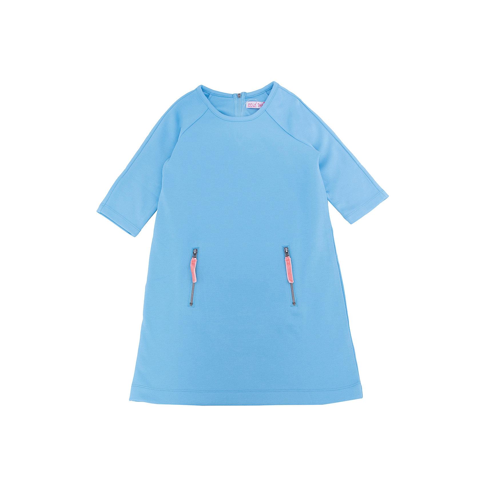 Платье для девочки SELAПлатья и сарафаны<br>Характеристики:<br><br>• Вид детской и подростковой одежды: платье<br>• Пол: для девочки<br>• Предназначение: повседневная, праздничная<br>• Сезон: круглый год<br>• Тематика рисунка: без рисунка<br>• Цвет: голубой <br>• Материал: 60% вискоза, 35% полиэстер, 5% эластан<br>• Силуэт: полуприлегающий<br>• Рукав: реглан, 3/4<br>• Воротник: круглый<br>• Застежка: молния сзади<br>• На передней полочке имеются карманы на молнии<br>• Длина платья: мини<br>• Особенности ухода: ручная стирка при температуре не более 30 градусов, глажение на щадящем режиме<br><br>Платье для девочки SELA из коллекции детской и подростковой одежды от знаменитого торгового бренда, который производит удобную, комфортную и стильную одежду, предназначенную как для будней, так и для праздников. Изделие выполнено из трикотажного полотна, в состав которого входит вискоза, полиэстер и эластан, что обеспечивает платью повышенную устойчивость к изменению формы и цвета. Платье выполнено в классическом стиле: полуприлегающий силуэт, рукав реглан 3/4 круглый воротник. Изделие выполнено в нежном небесном цвете, декорировано застежками молниями. <br><br>Платье для девочки SELA можно купить в нашем интернет-магазине.<br><br>Ширина мм: 236<br>Глубина мм: 16<br>Высота мм: 184<br>Вес г: 177<br>Цвет: голубой<br>Возраст от месяцев: 96<br>Возраст до месяцев: 108<br>Пол: Женский<br>Возраст: Детский<br>Размер: 134,140,146,152,116,122,128<br>SKU: 5305332