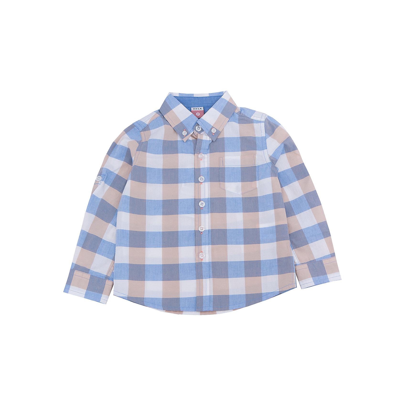 Рубашка для мальчика SELAБлузки и рубашки<br>Характеристики товара:<br><br>• цвет: голубой/бежевый<br>• состав: 100% хлопок<br>• силуэт прямой<br>• пуговицы<br>• длинные рукава с опций подгибки<br>• воротник баттен-даун<br>• карманы<br>• коллекция весна-лето 2017<br>• страна бренда: Российская Федерация<br>• страна изготовитель: Китай<br><br>Вещи из новой коллекции SELA продолжают радовать удобством! Модная рубашка для мальчика поможет разнообразить гардероб ребенка и обеспечить комфорт. Она отлично сочетается с джинсами и брюками. Очень стильно смотрится!<br><br>Одежда, обувь и аксессуары от российского бренда SELA не зря пользуются большой популярностью у детей и взрослых! Модели этой марки - стильные и удобные, цена при этом неизменно остается доступной. Для их производства используются только безопасные, качественные материалы и фурнитура. Новая коллекция поддерживает хорошие традиции бренда! <br><br>Рубашку для мальчика от популярного бренда SELA (СЕЛА) можно купить в нашем интернет-магазине.<br><br>Ширина мм: 174<br>Глубина мм: 10<br>Высота мм: 169<br>Вес г: 157<br>Цвет: синий<br>Возраст от месяцев: 60<br>Возраст до месяцев: 72<br>Пол: Мужской<br>Возраст: Детский<br>Размер: 116,92,98,104,110<br>SKU: 5305487