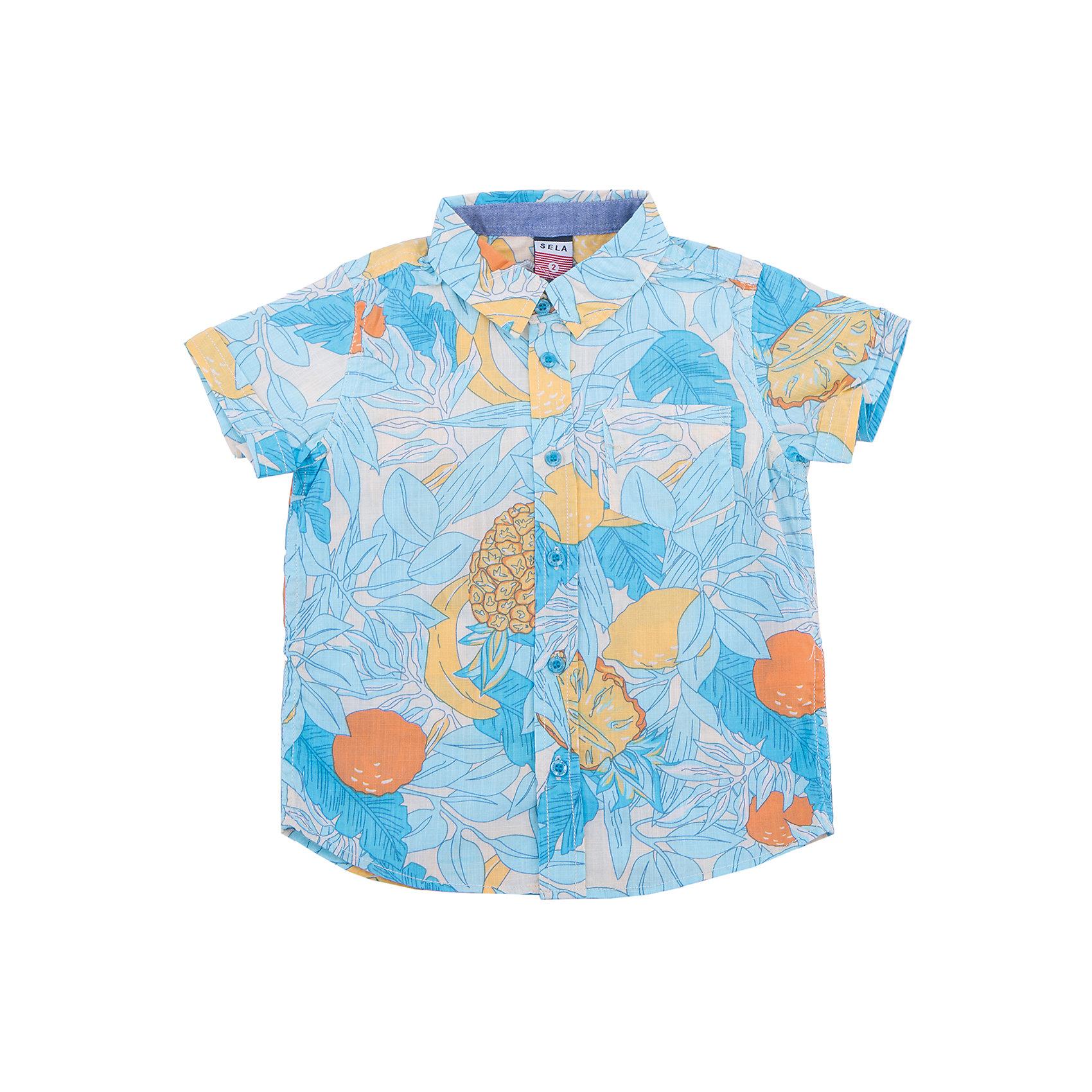 Рубашка для мальчика SELAБлузки и рубашки<br>Характеристики товара:<br><br>• цвет: голубой<br>• сезон: лето<br>• состав: 100% хлопок<br>• пуговицы<br>• короткие рукава<br>• отложной воротник<br>• принт<br>• страна бренда: Россия<br><br>Модная рубашка для мальчика разнообразит гардероб ребенка. Она отлично сочетается с джинсами, брюками или шортами. Очень стильно смотрится!<br><br>Одежда, обувь и аксессуары от российского бренда SELA не зря пользуются большой популярностью у детей и взрослых! Модели этой марки - стильные и удобные, цена при этом неизменно остается доступной. <br><br>Рубашку для мальчика от популярного бренда SELA (СЕЛА) можно купить в нашем интернет-магазине.<br><br>Ширина мм: 174<br>Глубина мм: 10<br>Высота мм: 169<br>Вес г: 157<br>Цвет: белый<br>Возраст от месяцев: 60<br>Возраст до месяцев: 72<br>Пол: Мужской<br>Возраст: Детский<br>Размер: 116,92,98,104,110<br>SKU: 5305544