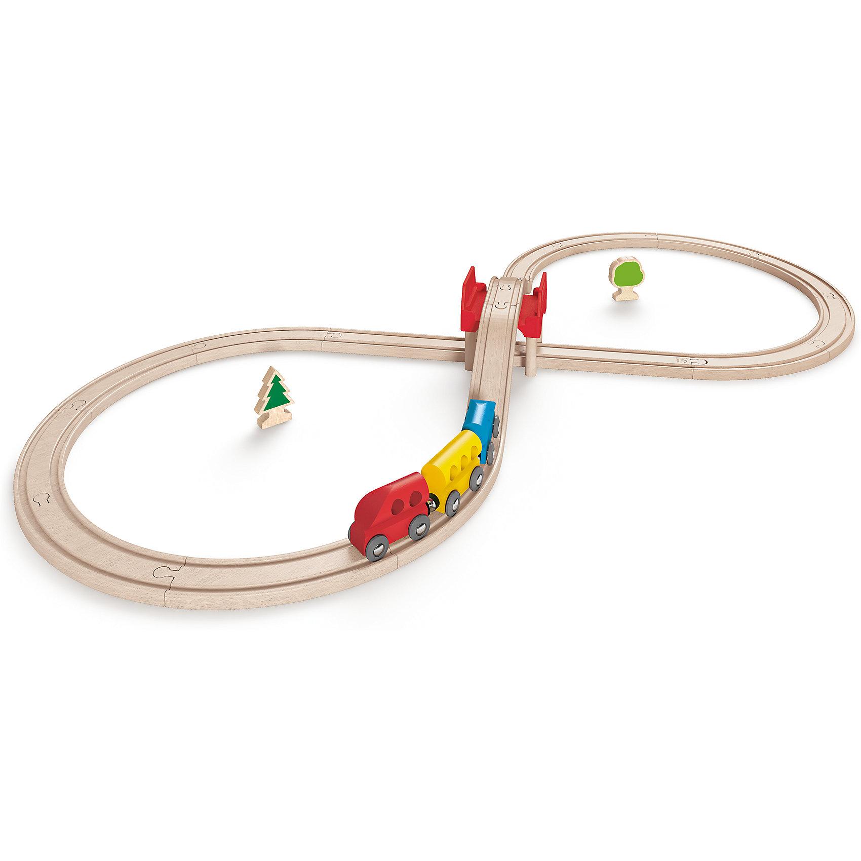 Игровой набор Железная дорога, HapeИгрушечная железная дорога<br>Игровой набор Железная дорога, Hape (Хейп).<br><br>Характеристики:<br><br>- В наборе: 17 элементов для сборки железной дороги, мост, два дерева, три вагончика - красный, голубой и желтый<br>- Протяженность дороги: 3 м.<br>- Размер в собранном виде: 48х6х24 см.<br>- Материал: древесина<br><br>Игровой набор состоит из железной дороги в виде восьмерки, трех вагонов и дополнительных элементов – двух деревьев и мостика. Яркие цвета вагонов и деревьев отлично сочетается с нежным и спокойным цветом железной дороги. Железная дорога собирается из отдельных элементов по принципу пазла.  Затруднений со сборкой железнодорожного полотна у ребенка не возникнет, так как элементы довольно крупные. Вагоны крепятся друг к другу магнитными элементами, расположенными в передней и задней частях, что позволяет беспрепятственно отсоединять их, комбинировать по ходу игры. Вагоны плавно и быстро едут по деревянным рельсам, а спускаясь с моста, могут по инерции проехать полный круг. Набор изготовлен из отлично отшлифованного, натурального дерева, окрашенного нетоксичной краской.  Играя с набором Железная дорога, ребенок будет не только получать удовольствие от игры, но и развивать мелкую моторику рук, фантазию, воображение, координацию движений, конструкторские и игровые навыки.<br><br>Игровой набор Железная дорога, Hape (Хейп) можно купить в нашем интернет-магазине.<br><br>Ширина мм: 60<br>Глубина мм: 480<br>Высота мм: 240<br>Вес г: 1467<br>Возраст от месяцев: 36<br>Возраст до месяцев: 84<br>Пол: Мужской<br>Возраст: Детский<br>SKU: 5309150