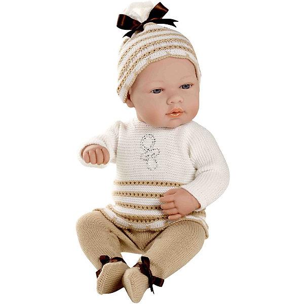 Пупс в бело-бежевом костюмчике со стразами Swarowski, 42см, AriasБренды кукол<br>Характеристики:<br><br>• Вид игр: сюжетно-ролевые<br>• Пол: для девочек<br>• Коллекция: Elegance<br>• Материал: винил, текстиль<br>• Длина пупса: 42 см<br>• Комплектация: кукла, маечка, трусики, пинетки<br>• Подвижные ручки и ножки <br>• Вес в упаковке: 1 кг 100 г<br>• Размеры упаковки (Г*Ш*В): 20*20*50 см<br>• Упаковка: картонная коробка<br>• Особенности ухода: куклу можно купать, одежда – ручная стирка<br><br>Пупс в бело-бежевом костюмчике со стразами Swarowski , 42см, Arias изготовлен известным испанским торговым предприятием Munecas, который специализируется на выпуске кукол и пупсов. Пупсы и куклы Arias с высокой степенью достоверности повторяют облик маленьких детей, благодаря мельчайшим деталям внешнего вида и одежды игрушки выглядят мило и очаровательно. Пунс выполнен из винила, у него подвижные ручки и ножки, четко прорисованные глаза и брови, курносый носик и пухленькие губки. Комплект одежды состоит из маечки и трусиков, выполненных ажурной вязкой белого и бежевого цветов. Маечка оформлена бантиком, выложенным стразами. На ножках у пупса – пинетки, на голове – чепчик. Пупс в бело-бежевом костюмчике со стразами Swarowski , 42см, Arias станет идеальным подарком для девочки к любому празднику.<br><br>Пупса в бело-бежевом костюмчике со стразами Swarowski , 42см, Arias можно купить в нашем интернет-магазине.<br><br>Ширина мм: 480<br>Глубина мм: 170<br>Высота мм: 260<br>Вес г: 1767<br>Возраст от месяцев: 36<br>Возраст до месяцев: 120<br>Пол: Женский<br>Возраст: Детский<br>SKU: 5355553