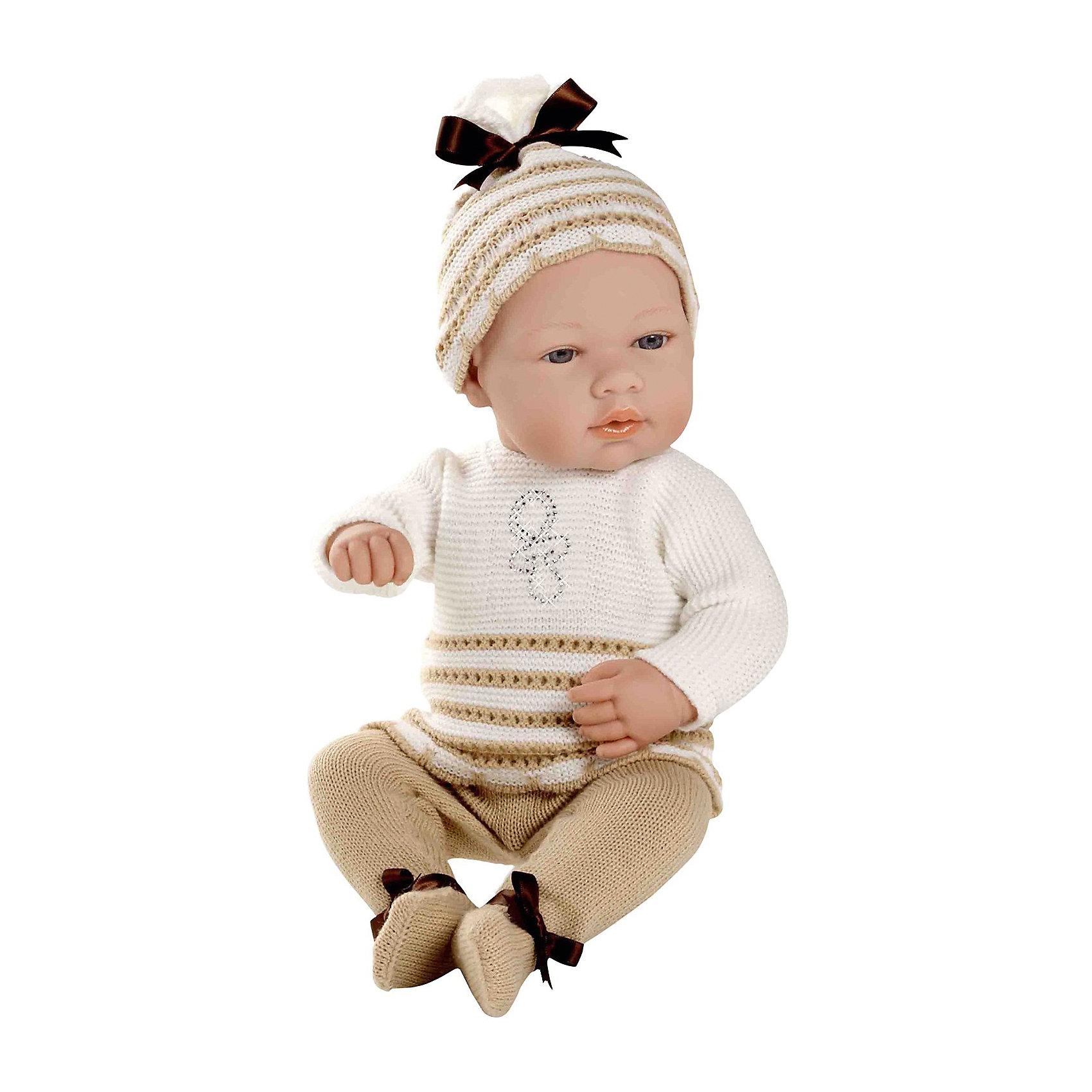 Пупс в бело-бежевом костюмчике со стразами Swarowski, 42см, AriasКуклы-пупсы<br>Характеристики:<br><br>• Вид игр: сюжетно-ролевые<br>• Пол: для девочек<br>• Коллекция: Elegance<br>• Материал: винил, текстиль<br>• Длина пупса: 42 см<br>• Комплектация: кукла, маечка, трусики, пинетки<br>• Подвижные ручки и ножки <br>• Вес в упаковке: 1 кг 100 г<br>• Размеры упаковки (Г*Ш*В): 20*20*50 см<br>• Упаковка: картонная коробка<br>• Особенности ухода: куклу можно купать, одежда – ручная стирка<br><br>Пупс в бело-бежевом костюмчике со стразами Swarowski , 42см, Arias изготовлен известным испанским торговым предприятием Munecas, который специализируется на выпуске кукол и пупсов. Пупсы и куклы Arias с высокой степенью достоверности повторяют облик маленьких детей, благодаря мельчайшим деталям внешнего вида и одежды игрушки выглядят мило и очаровательно. Пунс выполнен из винила, у него подвижные ручки и ножки, четко прорисованные глаза и брови, курносый носик и пухленькие губки. Комплект одежды состоит из маечки и трусиков, выполненных ажурной вязкой белого и бежевого цветов. Маечка оформлена бантиком, выложенным стразами. На ножках у пупса – пинетки, на голове – чепчик. Пупс в бело-бежевом костюмчике со стразами Swarowski , 42см, Arias станет идеальным подарком для девочки к любому празднику.<br><br>Пупса в бело-бежевом костюмчике со стразами Swarowski , 42см, Arias можно купить в нашем интернет-магазине.<br><br>Ширина мм: 480<br>Глубина мм: 170<br>Высота мм: 260<br>Вес г: 1767<br>Возраст от месяцев: 36<br>Возраст до месяцев: 120<br>Пол: Женский<br>Возраст: Детский<br>SKU: 5355553
