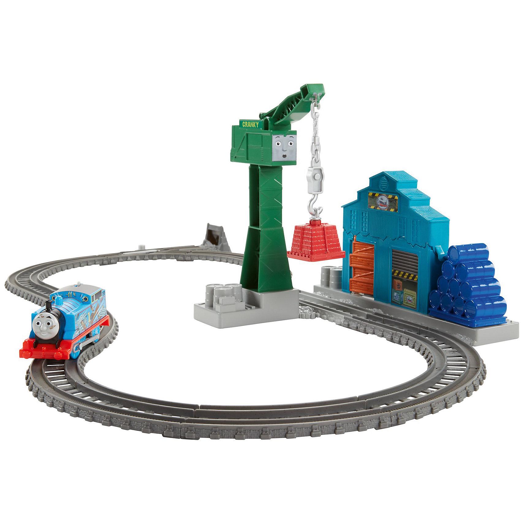 Набор с паровозиком Томасом и подъемным краном Крэнки, Томас и его друзьяТомас и его друзья<br>Набор с паровозиком Томасом и подъемным краном Крэнки, Томас и его друзья.<br><br>Характеристики:<br><br>• В наборе: элементы железной дороги, моторизированный паровозик Томас, подъемный кран Крэнки, здание склада<br>• Материал: пластик<br>• Длина паровозика: 12 см.<br>• Батарейки: 2 типа ААА 1,5V (в комплект не входят)<br>• Упаковка: картонная коробка<br>• Размер упаковки: 36х27х8 см.<br><br>С набором железной дороги Томас и его друзья вашему ребенку предстоит снести здание склада! Пока моторизированный паровозик Томас едет по дороге, ребенок может направить груз, висящий на крюке Крэнки, прямо в здание склада. Склад развалится на части! <br><br>А Томас проедет прямо сквозь развалины. Все элементы набора выполнены из высококачественного пластика и покрыты нетоксичными красками. Набор можно объединить с другими наборами серии Trackmaster, чтобы построить большую железную дорогу!<br><br>Набор с паровозиком Томасом и подъемным краном Крэнки, Томас и его друзья можно купить в нашем интернет-магазине.<br><br>Ширина мм: 360<br>Глубина мм: 80<br>Высота мм: 270<br>Вес г: 865<br>Возраст от месяцев: 36<br>Возраст до месяцев: 120<br>Пол: Мужской<br>Возраст: Детский<br>SKU: 5378277