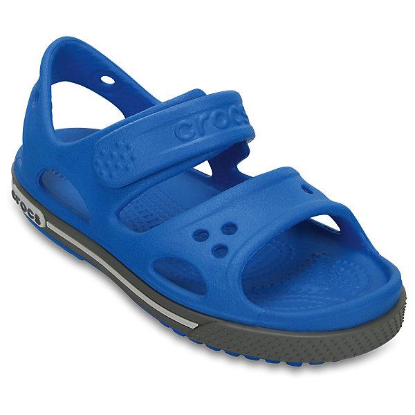 Сандалии для мальчика Kids' Crocband™ II Sandal CROCSПляжная обувь<br>Характеристики товара:<br><br>• цвет: синий<br>• сезон: лето<br>• материал: 100% полимер Croslite™<br>• бактериостатичный материал<br>• ремешок фиксирует стопу<br>• антискользящая устойчивая подошва<br>• липучка<br>• анатомическая стелька с массажными точками<br>• страна бренда: США<br>• страна изготовитель: Китай<br><br>Для правильного развития ребенка крайне важно, чтобы обувь была удобной.<br><br>Такие сандалии обеспечивают детям необходимый комфорт, а анатомическая стелька с массажными линиями для стимуляции кровообращения позволяет ножкам дольше не уставать. <br><br>Сандалии легко надеваются и снимаются, отлично сидят на ноге. <br><br>Материал, из которого они сделаны, не дает размножаться бактериям, поэтому такая обувь препятствует образованию неприятного запаха и появлению болезней стоп. <br><br>Обувь от американского бренда Crocs в данный момент завоевала широкую популярность во всем мире, и это не удивительно - ведь она невероятно удобна. <br><br>Сандалии Kids' Crocband™ II Sandal от торговой марки Crocs можно купить в нашем интернет-магазине.<br><br>Ширина мм: 219<br>Глубина мм: 154<br>Высота мм: 121<br>Вес г: 343<br>Цвет: синий<br>Возраст от месяцев: 21<br>Возраст до месяцев: 24<br>Пол: Мужской<br>Возраст: Детский<br>Размер: 24,27,34/35,33/34,31/32,26,25,23,22,21,30,29,28<br>SKU: 5416619