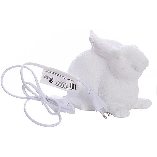 Лампа настольная Заяц, электрическая из фарфора, Феникс-ПрезентДетские предметы интерьера<br>Лампа настольная Заяц, электрическая из фарфора, Феникс-Презент<br><br>Характеристики:<br><br>• красивый светильник в форме зайца<br>• лампа накаливания 220-250 В, 50 Гц<br>• материал: фарфор<br>• размер: 18х14х11,5 см<br><br>Настольная лампа Заяц порадует любителей оригинальных светильников. Она выполнена в форме небольшого зайца. Лампа изготовлена из качественного фарфора. Светильник наполнит комнату мягким светом и порадует вас своей красотой.<br><br>Лампу настольную Заяц, электрическую из фарфора, Феникс-Презент вы можете купить в нашем интернет-магазине.<br><br>Ширина мм: 500<br>Глубина мм: 410<br>Высота мм: 410<br>Вес г: 9250<br>Возраст от месяцев: 120<br>Возраст до месяцев: 2147483647<br>Пол: Унисекс<br>Возраст: Детский<br>SKU: 5449756