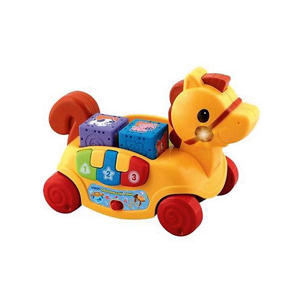 Обучающий пони, VtechИнтерактивные игрушки для малышей<br>Характеристики:<br><br>• Материал: пластик <br>• Комплектация: пони-каталка, 4 кубика, встроенное пианино с 3-мя клавишами<br>• Наличие музыки<br>• Световые эффекты<br>• 2 режима: игра и обучение<br>• Грани у кубиков округлые<br>• Батарейки: 2 шт. типа АА (предусмотрены в комплекте)<br>• Размер пони (длина): 28,5 см<br>• Размер упаковки (Д*Ш*В): 30*17*25 см<br>• Вес: 1 кг 305 г<br>• Подарочная упаковка<br>• Особенности ухода: допускается сухая и влажная чистка<br><br>Обучающий пони, Vtech – это многофункциональная интерактивная игрушка от французского производителя, который является мировым лидером по выпуску электронных обучающих устройств и игрушек. Игрушка выполнена в виде пони на колесиках. Сбоку предусмотрено пианино из трех клавиш, на спинке – ячейки для кубиков. <br><br>При нажатии на гриву начинают звучать мелодии и песенки, одновременно работает подсветка. Также звуковые и световые эффекты работают в процессе катания игрушки. В комплекте предусмотрены 4 интерактивных кубика, на разных гранях нанесены рисунки, буквы или выпуклые элементы. <br><br>С обучающим пони, Vtech легко будет изучить основные цвета, формы и звуки. Кубики с рельефной поверхностью будут способствовать развитию тактильного восприятия. <br><br>Обучающего пони, Vtech можно купить в нашем интернет-магазине.<br><br>Ширина мм: 305<br>Глубина мм: 241<br>Высота мм: 163<br>Вес г: 1200<br>Возраст от месяцев: 9<br>Возраст до месяцев: 36<br>Пол: Унисекс<br>Возраст: Детский<br>SKU: 5471067