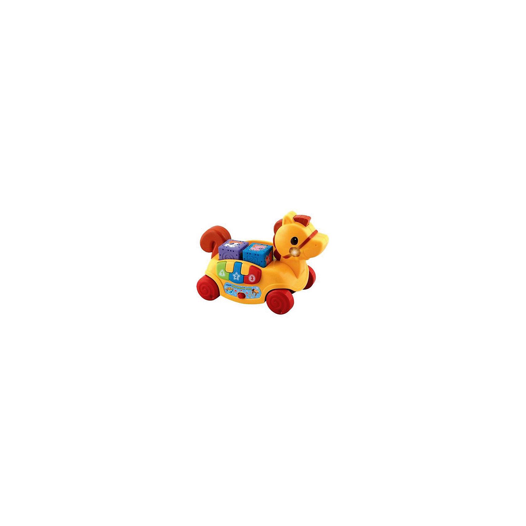 Обучающий пони, VtechИнтерактивные игрушки для девочек<br>Характеристики:<br><br>• Материал: пластик <br>• Комплектация: пони-каталка, 4 кубика, встроенное пианино с 3-мя клавишами<br>• Наличие музыки<br>• Световые эффекты<br>• 2 режима: игра и обучение<br>• Грани у кубиков округлые<br>• Батарейки: 2 шт. типа АА (предусмотрены в комплекте)<br>• Размер пони (длина): 28,5 см<br>• Размер упаковки (Д*Ш*В): 30*17*25 см<br>• Вес: 1 кг 305 г<br>• Подарочная упаковка<br>• Особенности ухода: допускается сухая и влажная чистка<br><br>Обучающий пони, Vtech – это многофункциональная интерактивная игрушка от французского производителя, который является мировым лидером по выпуску электронных обучающих устройств и игрушек. Игрушка выполнена в виде пони на колесиках. Сбоку предусмотрено пианино из трех клавиш, на спинке – ячейки для кубиков. <br><br>При нажатии на гриву начинают звучать мелодии и песенки, одновременно работает подсветка. Также звуковые и световые эффекты работают в процессе катания игрушки. В комплекте предусмотрены 4 интерактивных кубика, на разных гранях нанесены рисунки, буквы или выпуклые элементы. <br><br>С обучающим пони, Vtech легко будет изучить основные цвета, формы и звуки. Кубики с рельефной поверхностью будут способствовать развитию тактильного восприятия. <br><br>Обучающего пони, Vtech можно купить в нашем интернет-магазине.<br><br>Ширина мм: 305<br>Глубина мм: 241<br>Высота мм: 163<br>Вес г: 1200<br>Возраст от месяцев: 9<br>Возраст до месяцев: 36<br>Пол: Унисекс<br>Возраст: Детский<br>SKU: 5471067