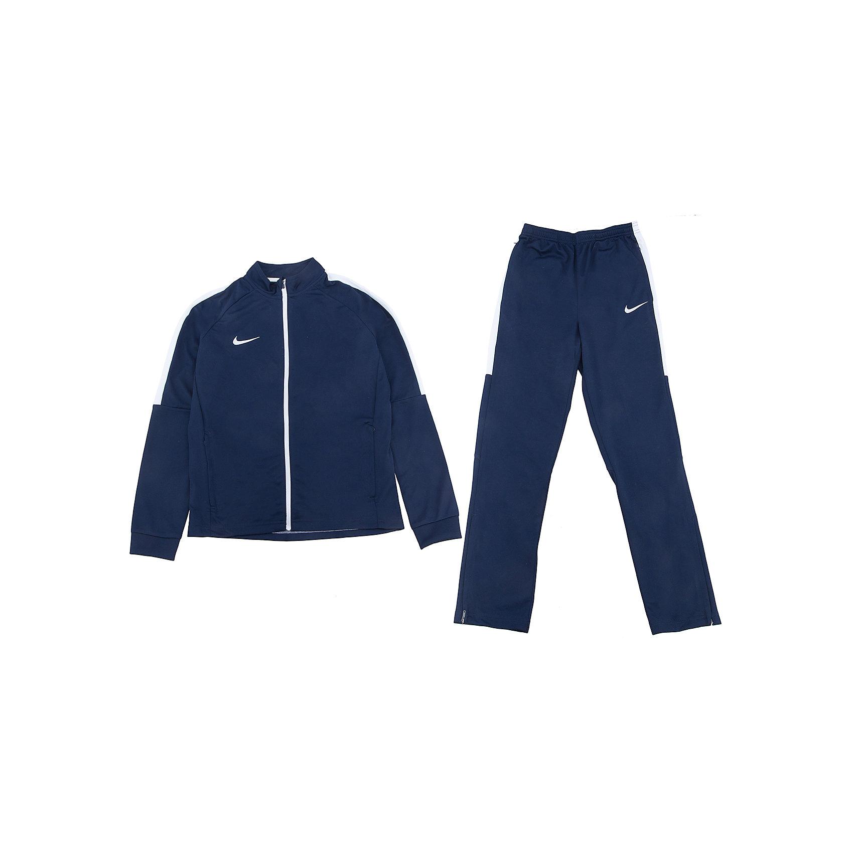 Спортивный костюм NIKEСпортивная форма<br>Характеристики товара:<br><br>• цвет: синий<br>• комплектация: курточка, брюки<br>• спортивный стиль<br>• состав: 100% полиэстер, Nike Dry<br>• мягкий пояс брюк<br>• комфортная посадка <br>• молния<br>• манжеты<br>• небольшой принт<br>• материал дарит ощущение прохлады и комфорт<br>• машинная стирка<br>• износостойкий материал<br>• страна бренда: США<br>• страна изготовитель: Индонезия<br><br>Продукция бренда NIKE известна высоким качеством и уникальным узнаваемым дизайном. Удобная посадка не сковывает движения, помогает создать для тела необходимую вентиляцию и вывод влаги.<br><br>Материал обеспечивает вещам долгий срок службы и отличный внешний вид даже после значительного количества стирок. Уход за изделием прост - достаточно машинной стирки на низкой температуре.<br><br>Качественный материал создает комфортную посадку, вещь при этом смотрится очень стильно. Благодаря универсальному цвету она отлично смотрится с разной одеждой и обувью.<br><br>Спортивный костюм NIKE (Найк) можно купить в нашем интернет-магазине.<br><br>Ширина мм: 247<br>Глубина мм: 16<br>Высота мм: 140<br>Вес г: 225<br>Цвет: синий<br>Возраст от месяцев: 168<br>Возраст до месяцев: 180<br>Пол: Унисекс<br>Возраст: Детский<br>Размер: 158/170,122/128,128/134,135/140,147/158<br>SKU: 5532771