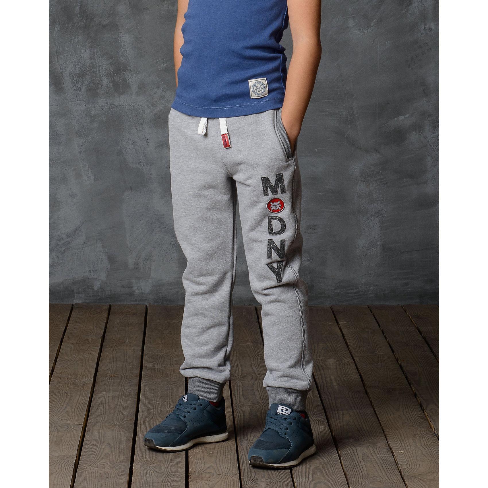 Брюки для мальчика Modniy JukБрюки<br>Характеристики товара:<br><br>• цвет: серый<br>• состав: 70% хлопок, 30% полиэстер<br>• спортивный силуэт<br>• карманы<br>• пояс - мягкая резинка<br>• манжеты<br>• логотип<br>• шнурок в поясе<br><br>• страна бренда: Российская Федерация<br>• страна производства: Российская Федерация<br><br>Модели одежды из новой коллекции от бренда Модный жук - это стильные и удобные вещи, созданные специально для детей. Они отличаются продуманным дизайном, качественными материалами и комфортной посадкой. Дети носят их с удовольствием! Стильные брюки спортивного силуэта - хит сезона, отличный вариант базовой вещи для разной погоды. Они отлично сочетаются с майками, футболками, куртками. Хорошо сидят по фигуре.<br>Одежда и аксессуары от российского бренда Модный жук - это способ пополнить гардероб ребенка модными изделиями по доступной цене. Для их производства используются только безопасные, проверенные материалы и фурнитура. Новая коллекция поддерживает хорошие традиции бренда! <br><br>Брюки для мальчика от популярного бренда Модный жук можно купить в нашем интернет-магазине.<br><br>Ширина мм: 215<br>Глубина мм: 88<br>Высота мм: 191<br>Вес г: 336<br>Цвет: серый<br>Возраст от месяцев: 12<br>Возраст до месяцев: 18<br>Пол: Мужской<br>Возраст: Детский<br>Размер: 86,110,92,98,104<br>SKU: 5613601