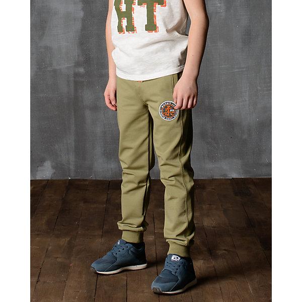 Брюки для мальчика Modniy JukБрюки<br>Характеристики товара:<br><br>• цвет: хаки<br>• состав: 70% хлопок, 30% полиэстер<br>• спортивный силуэт<br>• карманы<br>• пояс - мягкая резинка<br>• манжеты<br>• логотип<br>• шнурок в поясе<br><br>• страна бренда: Российская Федерация<br>• страна производства: Российская Федерация<br><br>Модели одежды из новой коллекции от бренда Модный жук - это стильные и удобные вещи, созданные специально для детей. Они отличаются продуманным дизайном, качественными материалами и комфортной посадкой. Дети носят их с удовольствием! Стильные брюки спортивного силуэта - хит сезона, отличный вариант базовой вещи для разной погоды. Они отлично сочетаются с майками, футболками, куртками. Хорошо сидят по фигуре.<br>Одежда и аксессуары от российского бренда Модный жук - это способ пополнить гардероб ребенка модными изделиями по доступной цене. Для их производства используются только безопасные, проверенные материалы и фурнитура. Новая коллекция поддерживает хорошие традиции бренда! <br><br>Брюки для мальчика от популярного бренда Модный жук можно купить в нашем интернет-магазине.<br><br>Ширина мм: 215<br>Глубина мм: 88<br>Высота мм: 191<br>Вес г: 336<br>Цвет: зеленый<br>Возраст от месяцев: 48<br>Возраст до месяцев: 60<br>Пол: Мужской<br>Возраст: Детский<br>Размер: 104/110,158/164,110/116,116/122,122/128,128/134,134/140,140/146,146/152,152/158<br>SKU: 5613694