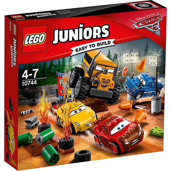 """Конструктор LEGO Juniors 10744 Тачки 3: Гонка """"Сумасшедшая восьмеркаПластмассовые конструкторы<br>Характеристики товара:<br><br>• возраст: от 4 лет;<br>• материал: пластик;<br>• в комплекте: 191 деталь, инструкция;<br>• размер упаковки: 28,2х26,2х6 см;<br>• вес упаковки: 485 гр.;<br>• страна производитель: Венгрия.<br><br>Конструктор Lego Juniors «Гонка Сумасшедшая восьмерка» создан по мотивам мультфильма «Тачки 3». Мисс Фриттер, большой желтый автобус с рожками, любит устраивать самые настоящие гонки на выживание. Именно в такой гонке предстоит участвовать Молнии МакКуину, Круз Рамирес и помощнику самой мисс Фриттер. Она подготовила для них 2 заграждения с острыми конусами, горящими шинами и бочками с топливом, которые могут взорваться в любой момент.<br><br>Из элементов предстоит собрать 4 машинки, стартовую площадку, 2 чек-пойнта. Все детали конструктора созданы из качественных безопасных материалов. В процессе сборки у ребенка развивается мелкая моторика рук, усидчивость, логическое мышление.<br><br>Конструктор Lego Juniors «Гонка Сумасшедшая восьмерка» можно приобрести в нашем интернет-магазине.<br>Ширина мм: 283; Глубина мм: 261; Высота мм: 66; Вес г: 472; Возраст от месяцев: 48; Возраст до месяцев: 2147483647; Пол: Мужской; Возраст: Детский; SKU: 5620058;"""