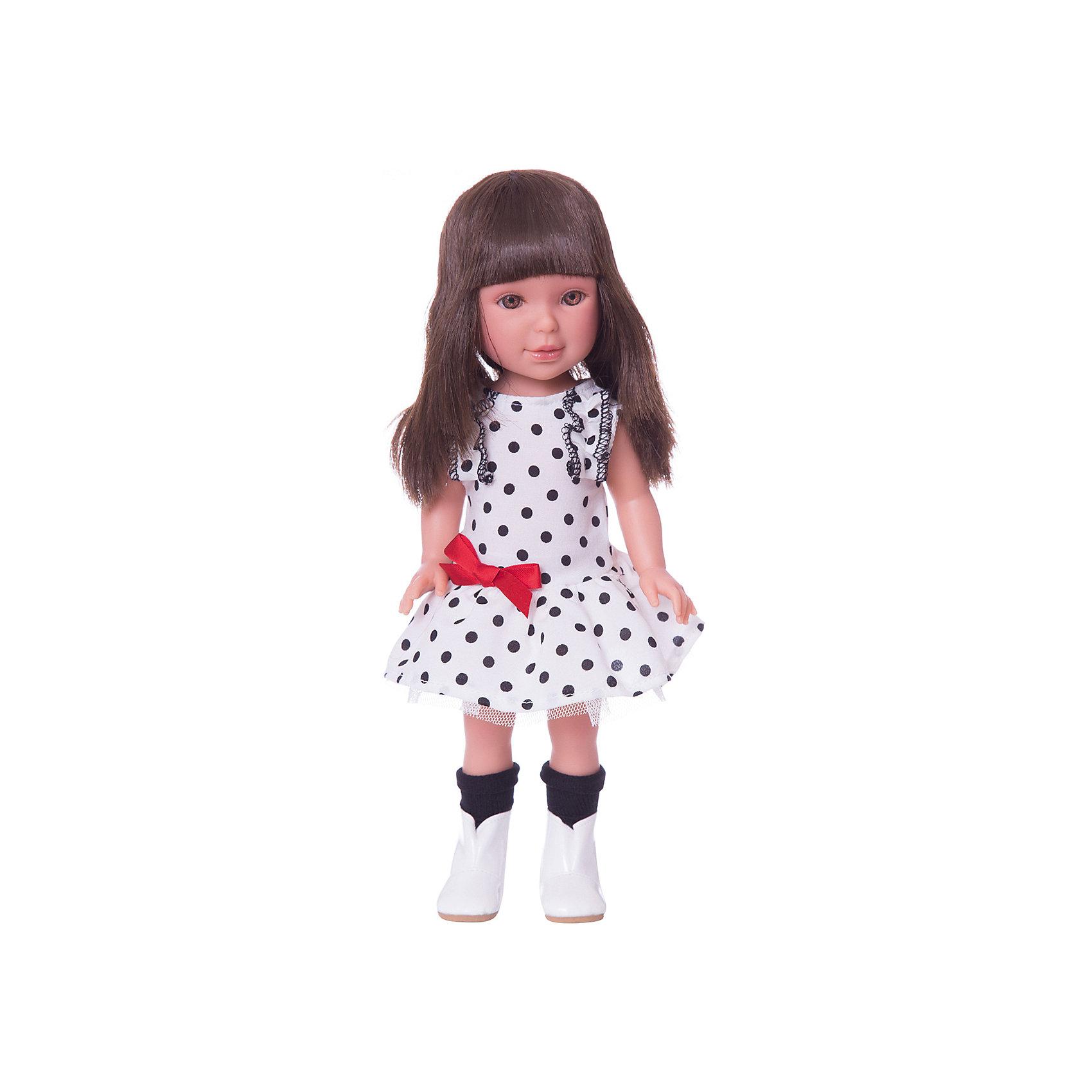 Кукла Паулина, брюнетка с челкой, Весна Техас, Vestida de AzulКлассические куклы<br>1. Хорошенькая брюнетка Паулина в стильном наряде: белое платье в горох с пышной юбкой, украшенная красным бантом, гольфы и сапоги. Броский весенний образ в стиле техас поможет сформировать вкус ребенка.<br>2. У куклы очень приятное и милое личико: щечки с легким румянцем, слегка вздернутый носик, пухлые губки и выразительные глаза с длинными ресницами, наклеенными вручную, которые выглядят как настоящие.<br>3. Длинные волосы куклы густо прошиты и напоминают натуральные. Челка прошита отдельно, а значит всегда будет красиво уложенной.  <br>4. Высокая детализация кукол: очень четко очерченные пальчики, складочки, румянец на щечках, коленках и локтях.<br>5. Кукла изготовлена из плотного гипоаллергенного винила без ароматизаторов, и умеет стоять без поддержи.<br>6. Подвижные руки, ноги и голова для незабываемой реалистичной игры.<br>7. Рост куклы - 33 см.<br><br>Ширина мм: 225<br>Глубина мм: 105<br>Высота мм: 405<br>Вес г: 700<br>Возраст от месяцев: 36<br>Возраст до месяцев: 2147483647<br>Пол: Женский<br>Возраст: Детский<br>SKU: 6844341