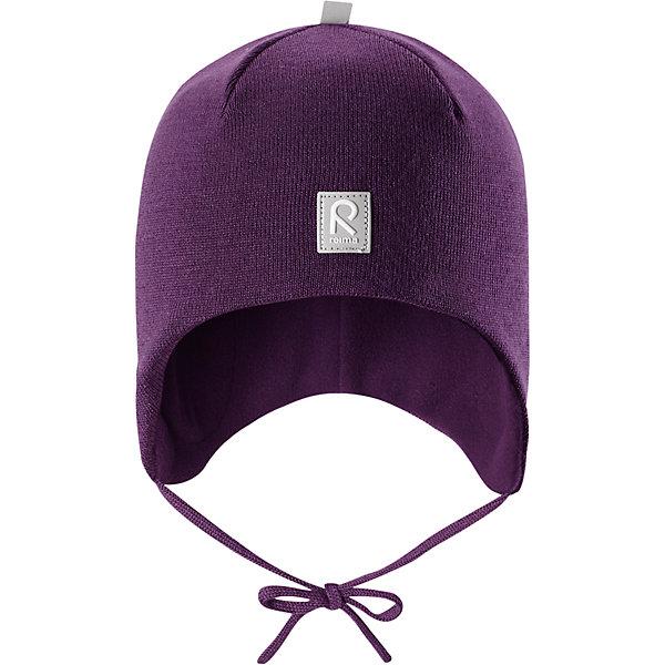 Шапка Reima Auva для девочкиШапки и шарфы<br>Характеристики товара:<br><br>• цвет: фиолетовый;<br>• состав: 100% шерсть;<br>• подкладка: 100% полиэстер, флис;<br>• температурный режим: от 0 до -20С;<br>• сезон: зима; <br>• особенности модели: вязаная, на подкладке, на завязках;<br>• мягкая ткань из мериносовой шерсти для поддержания идеальной температуры тела;<br>• сплошная подкладка: мягкий флис;<br>• ветронепроницаемые вставки в области ушей;<br>• светоотражающая эмблема;<br>• логотип Reima спереди;<br>• страна бренда: Финляндия;<br>• страна изготовитель: Китай.<br><br>Вязаная шапка на завязках для малышей из мериносовой шерсти подарит уют в морозную погоду: мягкая подкладка из флиса обеспечит ребенку тепло и комфорт. Шерстяная шапка с флисовой подкладкой идеально подходит для маленьких любителей приключений на свежем воздухе, ведь флис быстро сохнет и выводит влагу. <br><br>За счет эластичной вязки шапка отлично сидит, а ветронепроницаемые вставки в области ушей защищают ушки от холодного ветра. Благодаря завязкам эта стильная шапка не съезжает и хорошо защищает голову. Создайте стильный теплый образ: сочетайте шапку с горловиной Star.<br><br>Шапка Auva Reima от финского бренда Reima (Рейма) можно купить в нашем интернет-магазине.<br>Ширина мм: 89; Глубина мм: 117; Высота мм: 44; Вес г: 155; Цвет: лиловый; Возраст от месяцев: 9; Возраст до месяцев: 12; Пол: Женский; Возраст: Детский; Размер: 46,52,50,48; SKU: 6907046;