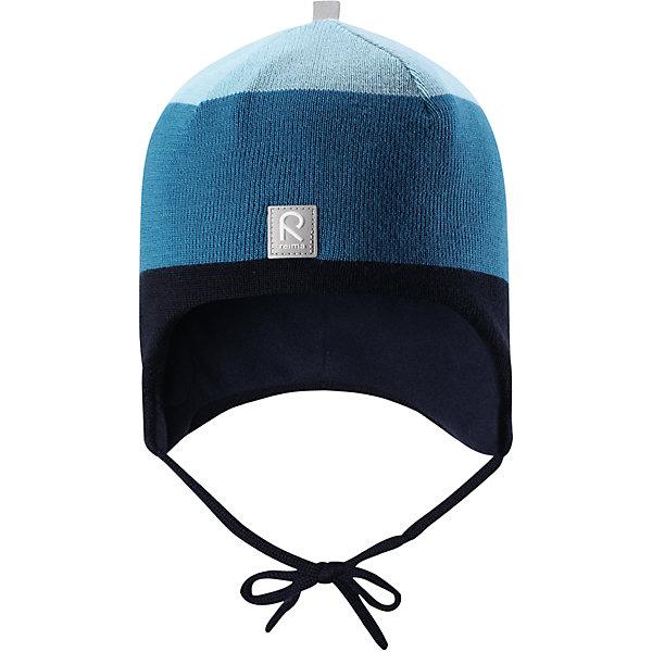 Шапка Reima Auva для мальчикаШапки и шарфы<br>Характеристики товара:<br><br>• цвет: синий/голубой;<br>• состав: 100% шерсть;<br>• подкладка: 100% полиэстер, флис;<br>• температурный режим: от 0 до -20С;<br>• сезон: зима; <br>• особенности модели: вязаная, на подкладке, на завязках;<br>• мягкая ткань из мериносовой шерсти для поддержания идеальной температуры тела;<br>• сплошная подкладка: мягкий флис;<br>• ветронепроницаемые вставки в области ушей;<br>• светоотражающая эмблема;<br>• логотип Reima спереди;<br>• страна бренда: Финляндия;<br>• страна изготовитель: Китай.<br><br>Вязаная шапка на завязках для малышей из мериносовой шерсти подарит уют в морозную погоду: мягкая подкладка из флиса обеспечит ребенку тепло и комфорт. Шерстяная шапка с флисовой подкладкой идеально подходит для маленьких любителей приключений на свежем воздухе, ведь флис быстро сохнет и выводит влагу. <br><br>За счет эластичной вязки шапка отлично сидит, а ветронепроницаемые вставки в области ушей защищают ушки от холодного ветра. Благодаря завязкам эта стильная шапка не съезжает и хорошо защищает голову. Создайте стильный теплый образ: сочетайте шапку с горловиной Star.<br><br>Шапка Auva Reima от финского бренда Reima (Рейма) можно купить в нашем интернет-магазине.<br>Ширина мм: 89; Глубина мм: 117; Высота мм: 44; Вес г: 155; Цвет: синий; Возраст от месяцев: 9; Возраст до месяцев: 12; Пол: Мужской; Возраст: Детский; Размер: 46,52,48,50; SKU: 6907056;