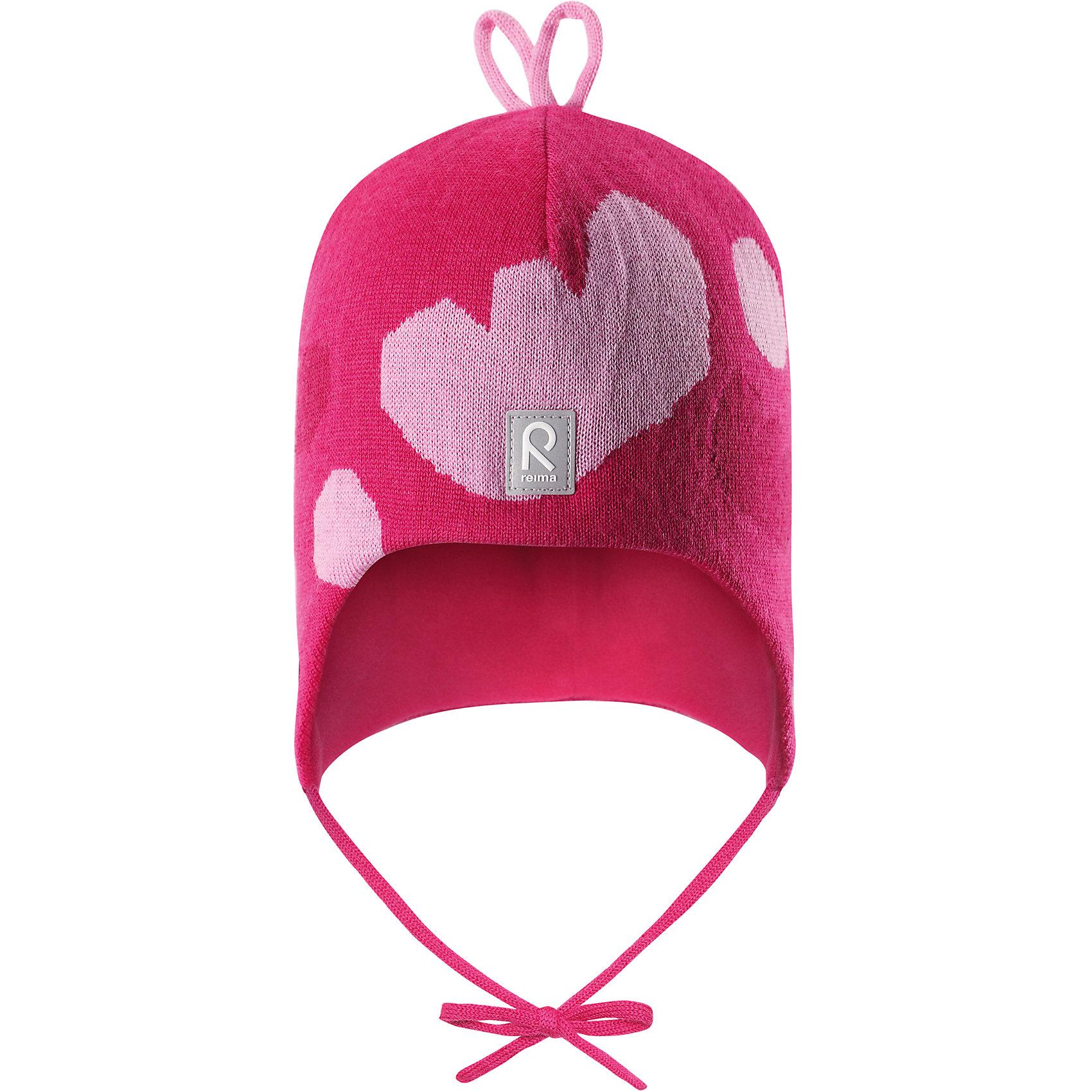 Шапка Reima Vatukka для девочкиГоловные уборы<br>Характеристики товара:<br><br>• цвет: розовый;<br>• состав: 100% шерсть;<br>• подкладка: 97% хлопок, 3% эластан;<br>• температурный режим: от 0 до -20С;<br>• сезон: зима; <br>• особенности модели: вязаная, на подкладке, на завязках;<br>• мягкая ткань из мериносовой шерсти для поддержания идеальной температуры тела;<br>• сплошная подкладка: мягкий трикотаж;<br>• ветронепроницаемые вставки в области ушей;<br>• светоотражающая эмблема;<br>• логотип Reima спереди;<br>• страна бренда: Финляндия;<br>• страна изготовитель: Китай.<br><br>Вязаная шапка на завязках для малышей из мериносовой шерсти подарит уют в морозную погоду: мягкая хлопковая подкладка обеспечит ребенку тепло и комфорт. За счет эластичной вязки шапка отлично сидит, а ветронепроницаемые вставки в области ушей защищают ушки от холодного ветра. Благодаря завязкам эта стильная шапка не съезжает и хорошо защищает голову. Бантик на макушке довершает образ.<br><br>Шапка Vatukka Reima для девочки от финского бренда Reima (Рейма) можно купить в нашем интернет-магазине.<br><br>Ширина мм: 89<br>Глубина мм: 117<br>Высота мм: 44<br>Вес г: 155<br>Цвет: розовый<br>Возраст от месяцев: 60<br>Возраст до месяцев: 72<br>Пол: Женский<br>Возраст: Детский<br>Размер: 52,46,48,50<br>SKU: 6907061