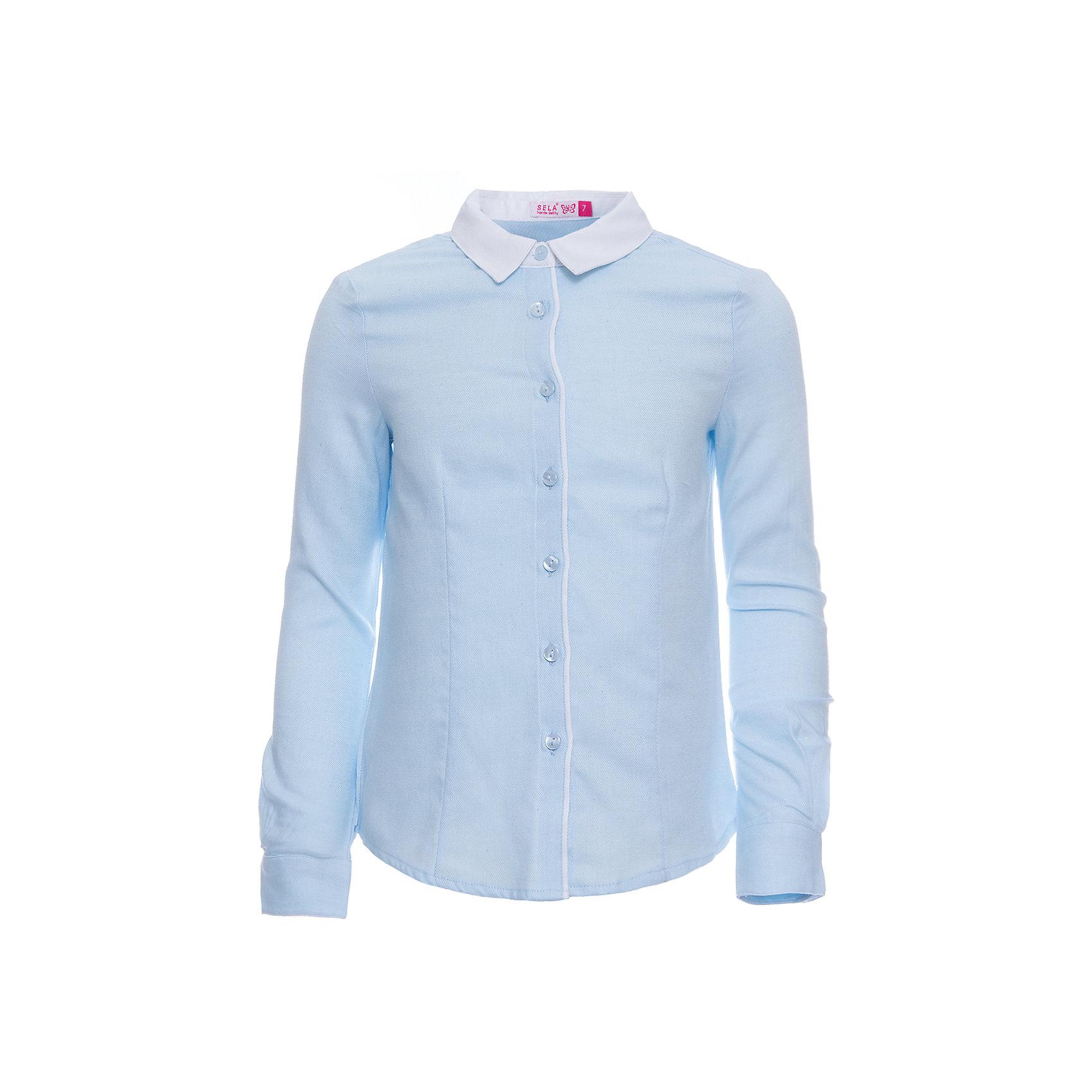 Блузка SELA для девочкиБлузки и рубашки<br>Характеристики товара:<br><br>• цвет: голубой;<br>• состав: 100% хлопок;<br>• сезон: демисезон;<br>• особенности: школьная;<br>• застежка: пуговицы<br>• манжеты на пуговице<br>• свободный крой;<br>• рукав: длинный;<br>• страна бренда: Россия;<br>• страна изготовитель: Китай.<br><br>Школьная блузка с длинным рукавом для девочки. Голубая блузка свободного кроя. Изготовлена из 100% хлопка. Застегивается на пуговицы. Манжеты блузки застегиваются на одну пуговицу.<br><br>Блузку Sela (Села) для девочки можно купить в нашем интернет-магазине.<br><br>Ширина мм: 186<br>Глубина мм: 87<br>Высота мм: 198<br>Вес г: 197<br>Цвет: лиловый<br>Возраст от месяцев: 156<br>Возраст до месяцев: 168<br>Пол: Женский<br>Возраст: Детский<br>Размер: 164,122,128,134,140,146,152<br>SKU: 7009447