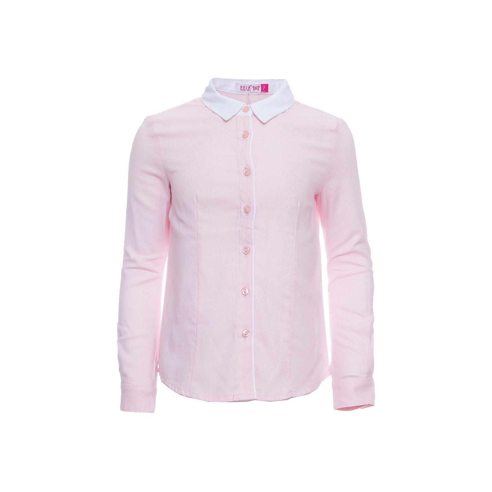 Блуза SELA для девочкиБлузки и рубашки<br>Характеристики товара:<br><br>• цвет: розовый;<br>• состав: 100% хлопок;<br>• сезон: демисезон;<br>• особенности: школьная;<br>• застежка: пуговицы<br>• манжеты на пуговице<br>• свободный крой;<br>• рукав: длинный;<br>• страна бренда: Россия;<br>• страна изготовитель: Китай.<br><br>Школьная блузка с длинным рукавом для девочки. Розовая блузка свободного кроя. Изготовлена из 100% хлопка. Застегивается на пуговицы. Манжеты блузки застегиваются на одну пуговицу.<br><br>Блузку Sela (Села) для девочки можно купить в нашем интернет-магазине.<br><br>Ширина мм: 186<br>Глубина мм: 87<br>Высота мм: 198<br>Вес г: 197<br>Цвет: розовый<br>Возраст от месяцев: 156<br>Возраст до месяцев: 168<br>Пол: Женский<br>Возраст: Детский<br>Размер: 164,122,128,134,140,146,152<br>SKU: 7009455