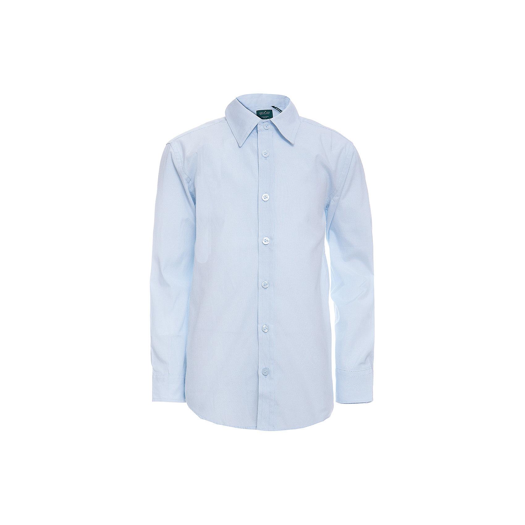Рубашка SELA для мальчикаБлузки и рубашки<br>Характеристики товара:<br><br>• цвет: голубой;<br>• состав: 60% хлопок, 40% полиэстер;<br>• сезон: круглый год;<br>• особенности: повседневная, школьная;<br>• застежка: пуговицы;<br>• манжеты на пуговицах;<br>• с длинным рукавом;<br>• страна бренда: Россия;<br>• страна изготовитель: Китай.<br><br>Школьная рубашка с длинным рукавом для мальчика. Рубашка выполнена в голубом цвете, застегивается на пуговицы. Манжеты с регулируемой шириной, застегиваются на две пуговицы.<br><br>Рубашку Sela (Села) для мальчика можно купить в нашем интернет-магазине.<br><br>Ширина мм: 174<br>Глубина мм: 10<br>Высота мм: 169<br>Вес г: 157<br>Цвет: голубой<br>Возраст от месяцев: 168<br>Возраст до месяцев: 180<br>Пол: Мужской<br>Возраст: Детский<br>Размер: 170,122,128,134,140,146,152,158,164<br>SKU: 7009788