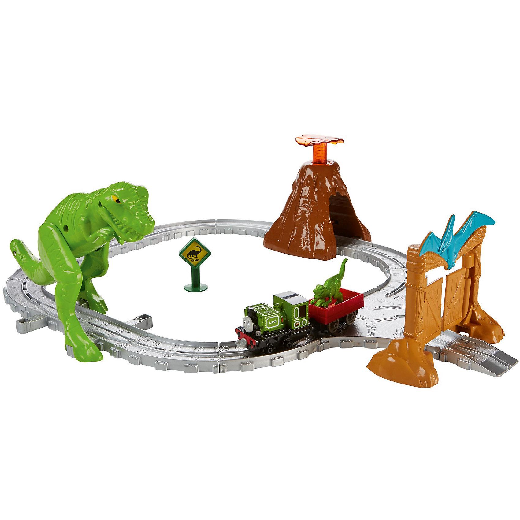Игровой набор Томас и его друзья Парк динозавровИгрушечная железная дорога<br>Характеристики товара:<br><br>• возраст: от 3 лет<br>• материал: пластик;<br>• размер упаковки: 26X20,5X6<br>• страна бренда: США<br><br>Люк хочет доставить особый груз в парк динозавров Эрла... но ночью накануне ему приснился сон, будто вместо окаменелостей он отправил настоящих живых динозавров! <br><br>Во сне Люк совершает путешествие, чтобы доставить малыша-динозавра его маме, сталкивается лицом к лицу с разъяренным тираннозавром и пытается убежать от извержения вулкана! Вулкан может «извергаться». Эффекты активируются, когда дети катают поезда по рельсам. Набор также включает большие ворота парка. <br><br>С игрушками серии «Приключения Томаса и его друзей™» ваш малыш отправится с Томасом туда, куда укажет его воображение!<br><br>Игровой набор Томас и его друзья Парк динозавров можно купить в нашем интернет-магазине.<br><br>Ширина мм: 280<br>Глубина мм: 95<br>Высота мм: 360<br>Вес г: 957<br>Возраст от месяцев: 36<br>Возраст до месяцев: 2147483647<br>Пол: Унисекс<br>Возраст: Детский<br>SKU: 7014745