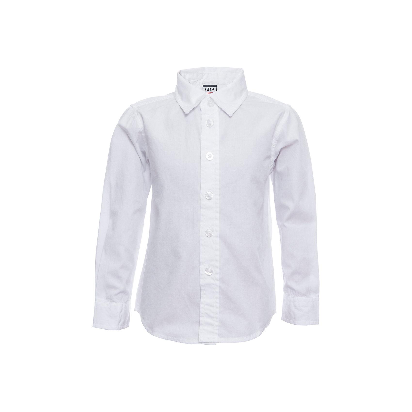 Рубашка SELA для мальчикаБлузки и рубашки<br>Характеристики товара:<br><br>• цвет: белый<br>• состав ткани: 100% хлопок<br>• сезон: демисезон<br>• особенности модели: школьная, нарядная<br>• застежка: пуговицы<br>• длинные рукава<br>• страна бренда: Россия<br>• страна производства: Индия<br><br>Белая рубашка для мальчика отличается классическим дизайном. Такая рубашка для мальчика - базовая вещь для гардероба. Эта рубашка для ребенка сшита из дышащего хлопкового материала. Модели от Sela стильные и удобные, как и эта детская рубашка с длинным рукавом. <br><br>Рубашку для мальчика Sela (Села) можно купить в нашем интернет-магазине.<br><br>Ширина мм: 174<br>Глубина мм: 10<br>Высота мм: 169<br>Вес г: 157<br>Цвет: белый<br>Возраст от месяцев: 24<br>Возраст до месяцев: 36<br>Пол: Мужской<br>Возраст: Детский<br>Размер: 98,104,110,116,92<br>SKU: 7032317