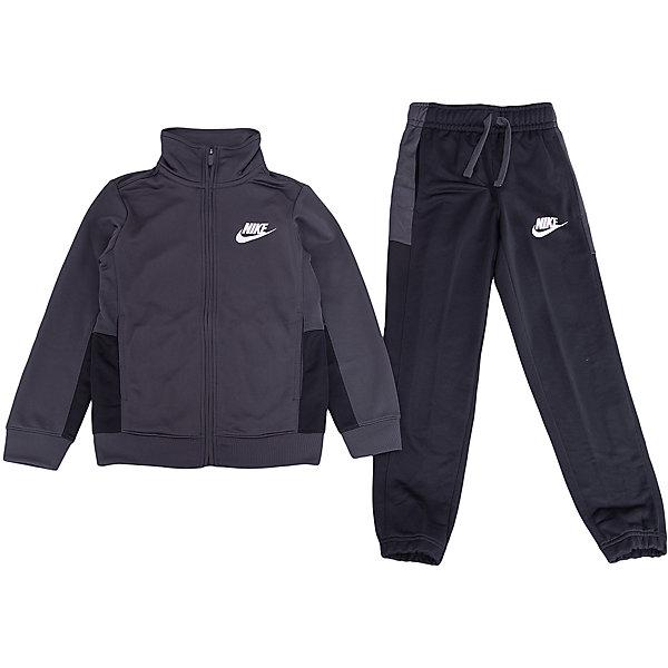 Спортивный костюм NIKEСпортивная одежда<br>Характеристики товара:<br><br>• цвет: черный<br>• комплектация: курточка, брюки<br>• состав ткани: 100% полиэстер <br>• длинные рукава<br>• застежка: молния<br>• пояс: резинка и шнурок<br>• особенности модели: спортивный стиль<br>• сезон: демисезон<br>• карманы: на молнии<br>• страна бренда: США<br>• страна изготовитель: Малайзия<br><br>Комфортный детский спортивный костюм Nike разработан с учетом последних тенденций молодежной моды. Спортивный костюм Найк не стесняет движения ребенка. Этот спортивный костюм Nike - удобная и стильная одежда для отдыха и занятий спортом. Спортивной комплект для детей дополнен карманами на молнии. <br><br>Спортивный костюм Nike (Найк) можно купить в нашем интернет-магазине.<br><br>Ширина мм: 247<br>Глубина мм: 16<br>Высота мм: 140<br>Вес г: 225<br>Цвет: черный<br>Возраст от месяцев: 84<br>Возраст до месяцев: 96<br>Пол: Унисекс<br>Возраст: Детский<br>Размер: 122/128,158/170,147/158,135/140,128/134<br>SKU: 7073922