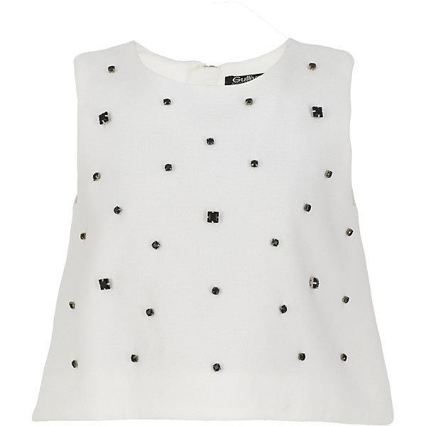 Блузка Gulliver для девочкиБлузки и рубашки<br>Характеристики товара:<br><br>• цвет: белый;<br>• состав: 100% полиэстер;<br>• подкладка: 100% хлопок;<br>• сезон: круглый год;<br>• особенности: нарядная, со стразами;<br>• застежка: двойная молния на спинке;<br>• без рукавов;<br>• округлый ворот;<br>• коллекция: Карнавальная ночь;<br>• страна бренда: Россия;<br>• страна изготовитель: Китай.<br><br>Блузка без рукавов для девочки. Легкая трапециевидная форма блузки не нарушит привычного комфорта, оформление передней части модели крупными черными бусинами подчеркнет торжественность и красоту момента. <br><br>Блузку Gulliver (Гулливер) можно купить в нашем интернет-магазине.<br>Ширина мм: 186; Глубина мм: 87; Высота мм: 198; Вес г: 197; Цвет: белый; Возраст от месяцев: 132; Возраст до месяцев: 144; Пол: Женский; Возраст: Детский; Размер: 152,146,164,158; SKU: 7077462;