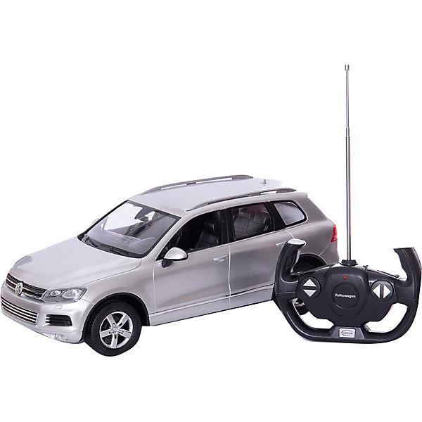 Радиоуправляемая машинка Rastar Volkswagen Touareg 1:14, серебристаяРадиоуправляемые машины<br>Характеристики:<br><br>• возраст: от 8 лет:<br>• материал: металл, пластик;<br>• масштаб: 1:14;<br>• максимальная скорость: до 12 км/ч;<br>• в комплекте: машина, пульт управления;<br>• тип батареек: 5 батареек АА; 1 батарейка Крона;<br>• наличие батареек: нет в комплекте;<br>• вес упаковки: 1,03 кг.;<br>• размер машины: 34,3х15,9х12,3 см;<br>• размер упаковки: 43х22,5х19,5 см;<br>• страна производитель: Китай.<br><br>Легендарный внедорожник в мини версии — радиоуправляемая машинка Rastar Volkswagen Touareg. Управление игрушкой осуществляется с помощью удобного пульта на частоте 27MHz, который позволяет ездить ей во все стороны на расстояние до 15 м.<br><br>Мощные колеса и амортизация приспособлены к езде не только по ровной поверхности дома, но и на улице по асфальту и бугристой дороге, бросая вызов всем препятствиям. Авто имеет задний привод и разгоняется на ровной дороге до 12 км/ч. Кроме того, когда машина едет вперед, включаются фары, а когда тормозит или сдает назад — стоп-сигналы. Время работы: 25 минут.<br><br>Мини автомобиль понравится и детям, и взрослым, особенно тем, кто коллекционирует подобные экземпляры или обладает оригиналом.<br><br>Радиоуправляемую машинку Rastar Volkswagen Touareg, 1:14 можно купить в нашем интернет-магазине.<br>Ширина мм: 430; Глубина мм: 225; Высота мм: 195; Вес г: 1033; Возраст от месяцев: 36; Возраст до месяцев: 180; Пол: Мужской; Возраст: Детский; SKU: 7345291;