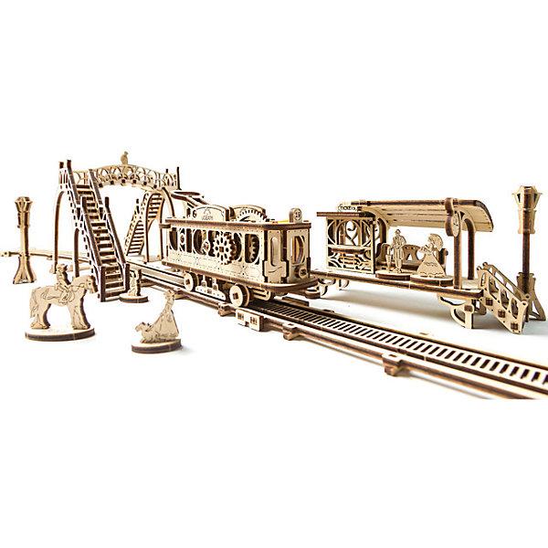 Конструктор 3D-пазл Ugears - Трамвайная линияДеревянные модели<br>Характеристики товара:<br><br>• количество деталей: 284;<br>• возраст: от 14 лет;<br>• материал: фанера;<br>• время сборки: 5 часов;<br>• размер модели: 90х18х12 см;<br>• размер упаковки: 37,5х14х3 см;<br>• страна бренда: Украина.<br><br>«Трамвайная линяя» - модель из серии Механический город от Ugears. В комплект входят фигурки людей, ожидающих трамвай на остановке. Вагончик трамвая подвижен, ездит по рельсам до депо. Все модели выполнены в стиле 19 века. Время сборки данной модели занимает около пяти часов. Все элементы изготовлены из экологически чистых материалов. Для работы не потребуется вырезать детали и пользоваться клеем.<br><br>Конструктор 3D-пазл Ugears (Югерс) - Трамвайная линия можно купить в нашем интернет-магазине.<br><br>Ширина мм: 375<br>Глубина мм: 140<br>Высота мм: 30<br>Вес г: 621<br>Возраст от месяцев: 168<br>Возраст до месяцев: 2147483647<br>Пол: Унисекс<br>Возраст: Детский<br>SKU: 7378820