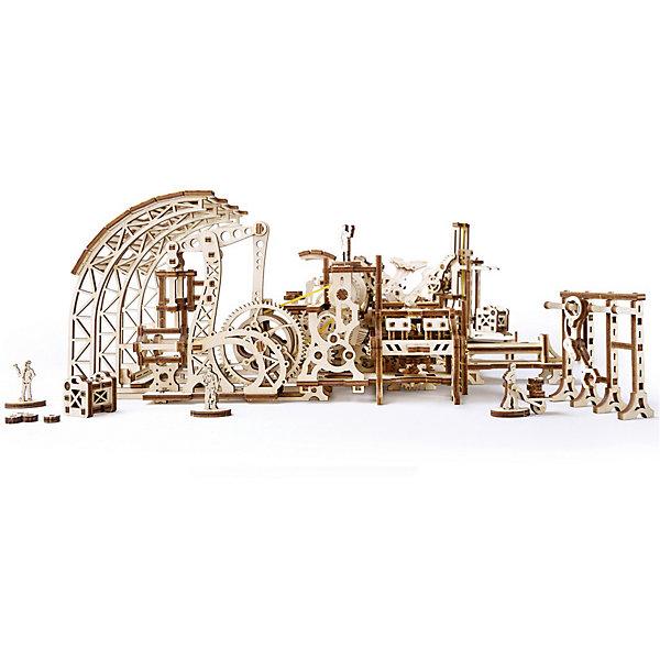 Конструктор 3D-пазл Ugears - Фабрика роботовДеревянные модели<br>Характеристики товара:<br><br>• количество деталей: 598;<br>• возраст: от 14 лет;<br>• материал: фанера;<br>• время сборки: 16-20 часов;<br>• размер модели: 44х29х14 см;<br>• размер упаковки: 37х13х4 см;<br>• страна бренда: Украина.<br><br>«Фабрика роботов» от Ugears - настоящий цех с полуавтоматизированной линией производства. Модель состоит из 598 деталей, выполненных из качественной, экологически чистой древесины. Для сборки не потребуются клей и инструменты: все детали вырезаны и готовы к работе. Время полной сборки занимает 16-20 часов. В комплект входит инструкция с подробным описанием сборки.<br><br>Для того, чтобы конструкция начала работать, достаточно лишь нажать на кнопку. При нажатии на кнопку механизм приводит в движение все шестеренки фабрики и поддерживает работу резиномоторов. В набор входят фигурки роботов с подвижными руками и ногами. Таким образом, фигурки роботов можно использовать для переноса различных грузов. Фигурки роботов можно собрать, задействуя специальный паз ленты. При перевозке тяжелых грузов можно воспользоваться лебедкой. Длина лебедки регулируется при помощи шестеренки.<br><br>Конструктор 3D-пазл Ugears (Югерс) - Фабрика роботов можно купить в нашем интернет-магазине.<br>Ширина мм: 375; Глубина мм: 136; Высота мм: 44; Вес г: 1175; Возраст от месяцев: 168; Возраст до месяцев: 2147483647; Пол: Унисекс; Возраст: Детский; SKU: 7378822;