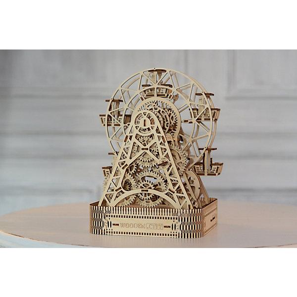 Сборная модель Колесо Обозрения Wooden CityДеревянные модели<br>Характеристики товара:<br><br>• количество деталей: 429;<br>• возраст: от 14 лет;<br>• время работы: 1 минута;<br>• время сборки: 7-9 часов;<br>• материал: фанера;<br>• размер упаковки: 5,1х24х35,5 см;<br>• страна бренда: Польша.<br><br>Сборное «Колесо обозрения» отличается открытым корпусом, что позволяет зрителям наблюдать за интереснейшим движением механизмов. Такая модель станет достойным украшением любой комнаты и приятным подарком для близких. Модель работает на основе резинопривода, который приводит зубчатые колеса в движение. В кабины колеса можно поставить небольшие игрушки, которые будут выполнять роль увлеченных пассажиров. Время работы от 1 завода - 1 минута.<br><br>Колесо обозрения собирается из 429 деталей, изготовленных из экологически чистой березовой фанеры. Все детали вырезаны, их необходимо только выдавить из основы. Для работы не требуются инструменты и клей. Ориентировочное время сборки данной модели - 7-9 часов.<br><br>Сборную модель Колесо Обозрения Wooden City (Вуден Сити) можно купить в нашем интернет-магазине.<br>Ширина мм: 355; Глубина мм: 240; Высота мм: 51; Вес г: 2300; Возраст от месяцев: 168; Возраст до месяцев: 2147483647; Пол: Унисекс; Возраст: Детский; SKU: 7421681;