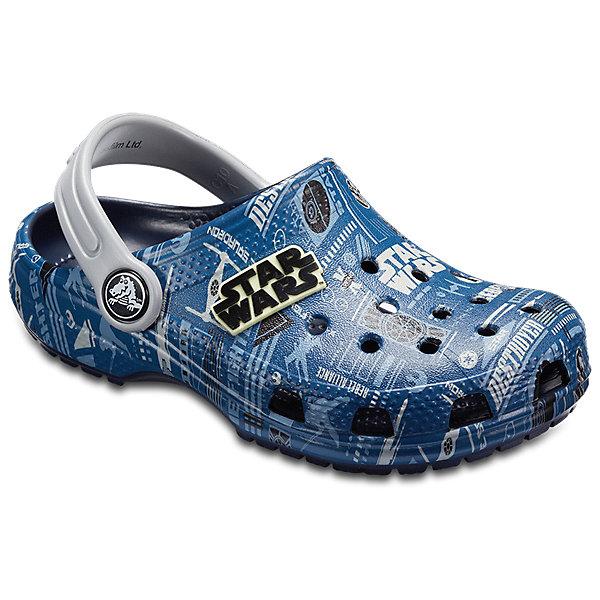 Сабо Star Wars CROCS для мальчикаПляжная обувь<br>Характеристики товара:<br><br>• модель: Classic Star Wars Grph Clog K<br>• цвет: синий;<br>• состав: 100% полимер Croslite™;<br>• сезон: лето;<br>• температурный режим: от +20;<br>• модель: закрытые;<br>• яркий принт;<br>• застежка: пяточный ремешок;<br>• непромокаемые;<br>• вентилируемые;<br>• рельефный рисунок подошвы;<br>• анатомические;<br>• светоотражающий логотип в области пятки;<br>• страна бренда: США<br><br>Сабо для мальчика Crocs  придутся по душе вашему ребенку, ведь они выполнены в яркой комбинации цветов с изображение героев фантастической саги Звездные войны. Такие сабо не оставят никого равнодушным. <br><br>Модель полностью выполнена из полимерного материала. Съемный пяточный ремешок, оформленный названием бренда, предназначен для фиксации стопы при ходьбе. Рифление на подошве гарантирует идеальное сцепление с любой поверхностью.<br><br>Благодаря материалу Croslite обувь невероятно легкая, мягкая и удобная. Материал Croslite - бактериостатичен, препятствует появлению неприятных запахов и легок в уходе: быстро сохнет и не оставляет следов на любых поверхностях. <br><br>Сабо для мальчика Star Wars CROCS  (Крокс) можно купить в нашем интернет-магазине.<br>Ширина мм: 225; Глубина мм: 139; Высота мм: 112; Вес г: 290; Цвет: синий; Возраст от месяцев: 12; Возраст до месяцев: 15; Пол: Мужской; Возраст: Детский; Размер: 21,34/35,33/34,31/32,30/31,29/30,28/29,27/28,26,25,24,23,22; SKU: 7841616;